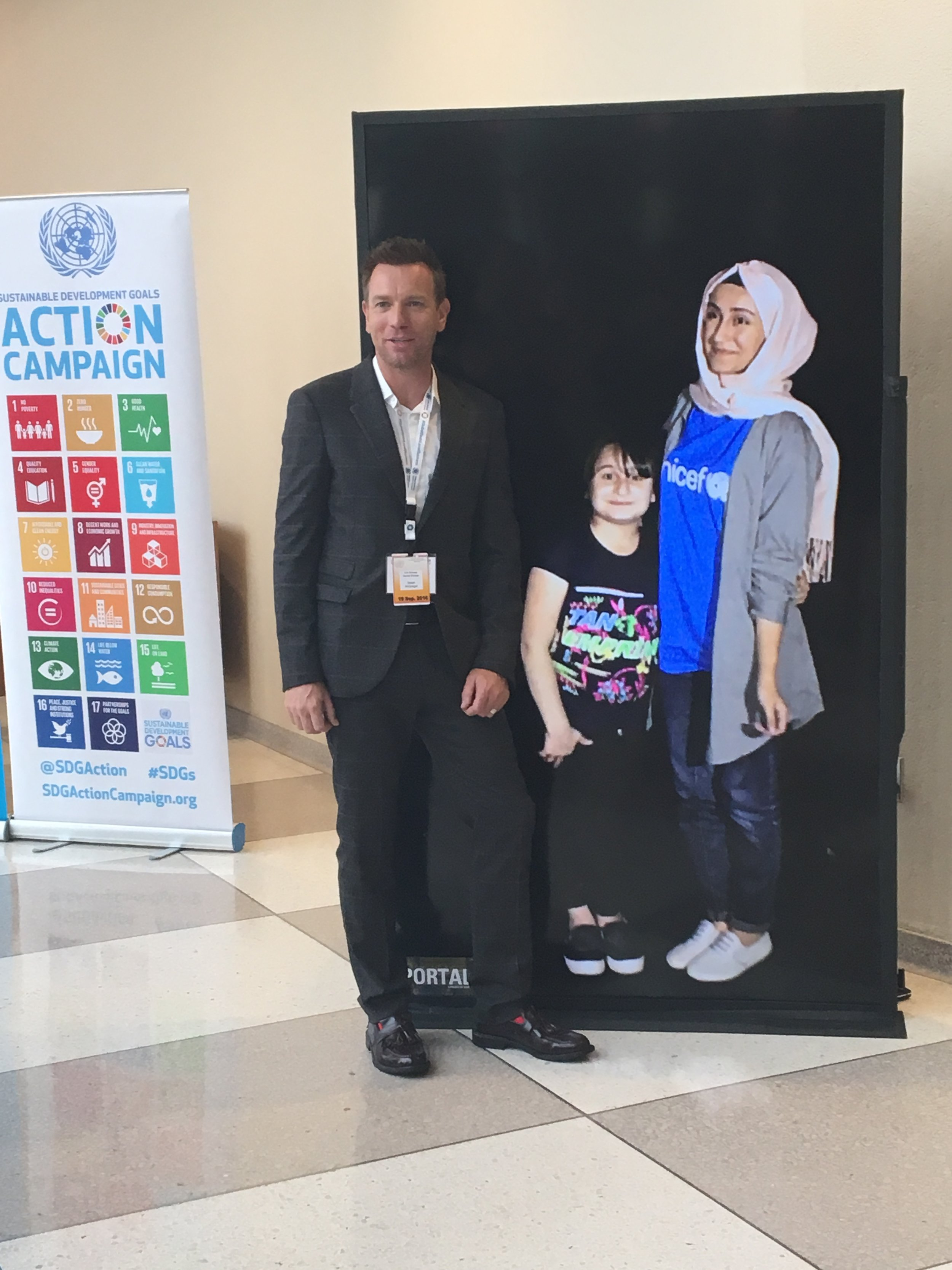 Actor Ewan McGregor speaking to a young girl in Erbil through a Portal Screen at the UN General Assembly Portal Screen