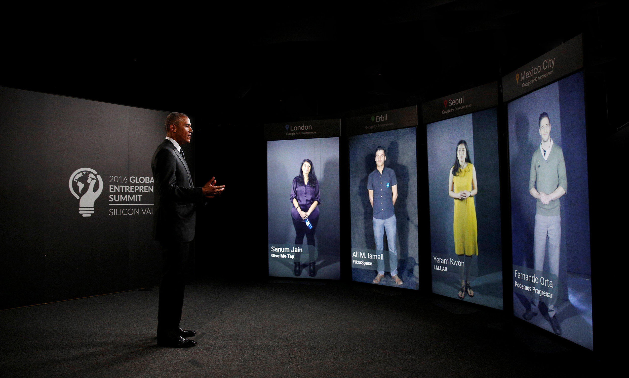 President Obama speaking to entrepreneurs in (from left to right) London, UK; Erbil Iraq; Seoul, South Korea; and Mexico City, Mexico through Portal_Screens at a Global Entrepreneurship Summit event hosted by Google for Entrepreneurs.   Download JPEG (1.5mb)