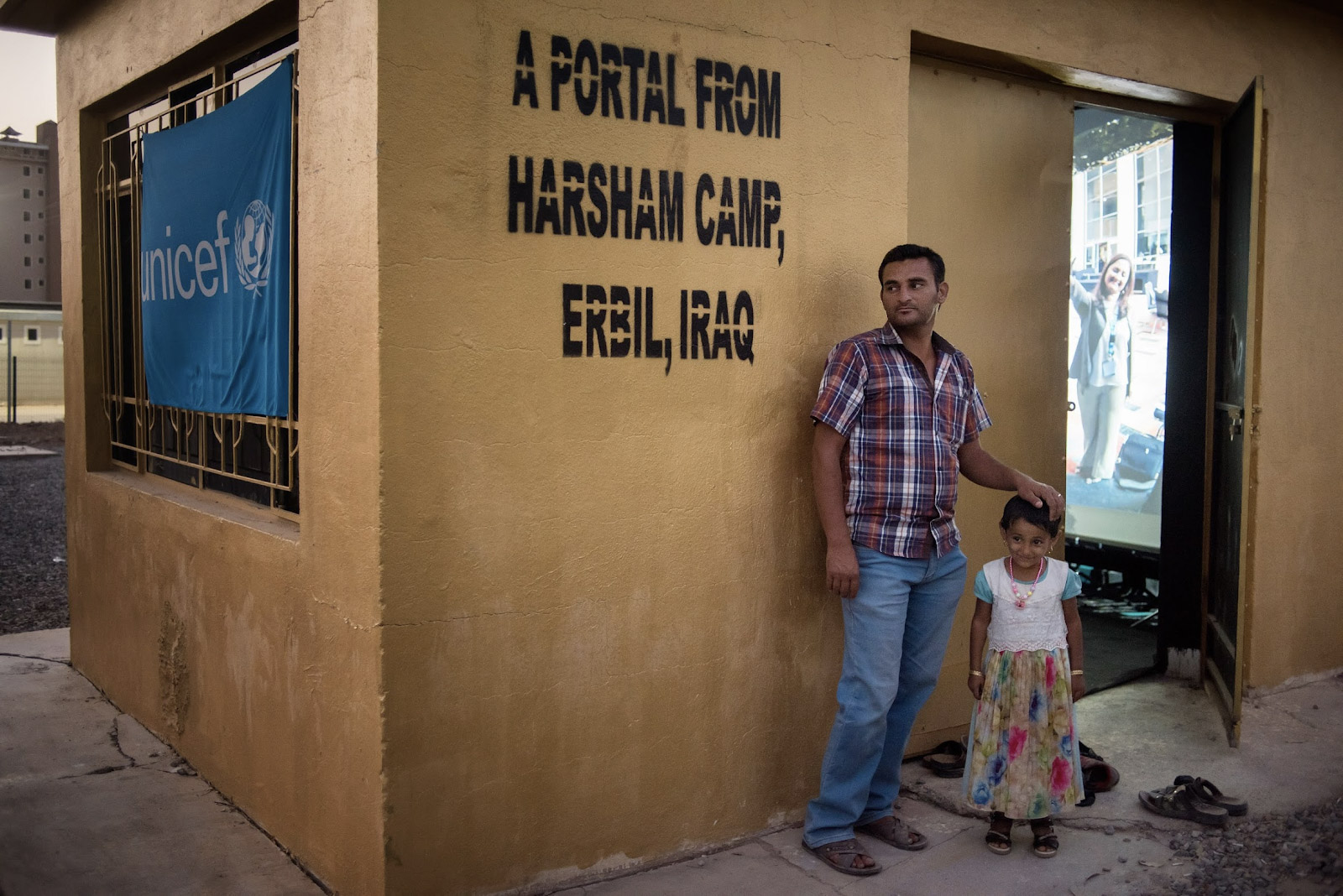 A father and daughter outside the Portal at the Harsham Camp for Internally Displaced Persons in Erbil, Iraq.