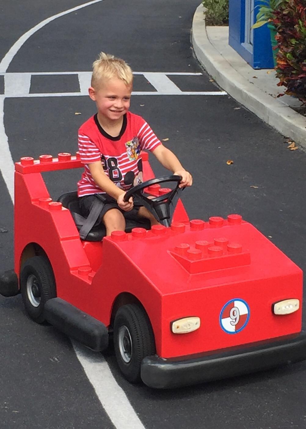Liam red car.jpeg