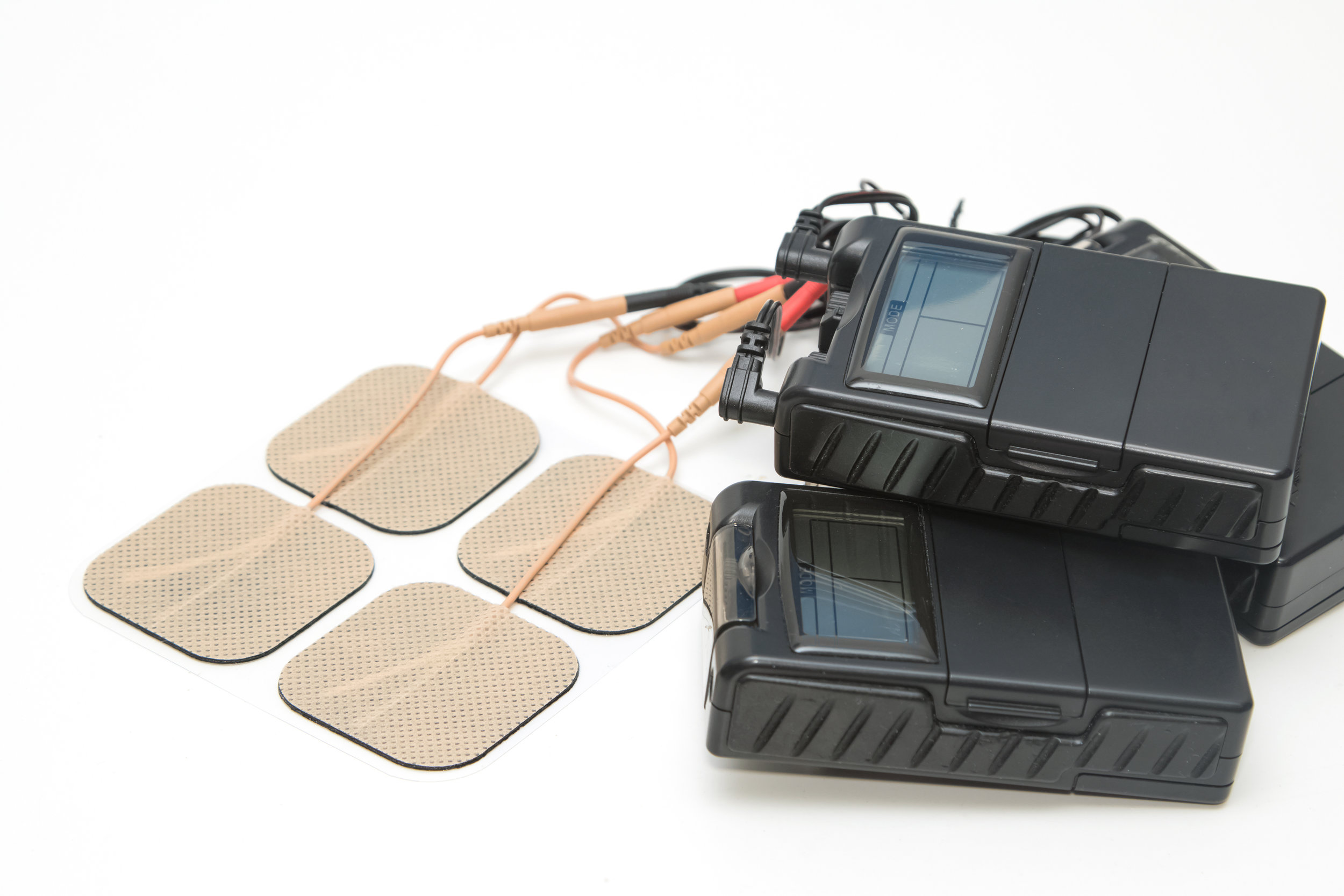 Electrotherapy - Many different types of electrotherapy modalities are available. Neuromuscular Electrical Stimulation (NMES) uses electrical stimulation to elicit muscle contraction by stimulating muscle fiber activity. NMES is useful in stimulating weak and atrophied muscle post-surgery or in the management of neurological cases. Transcutaneous Electrical Stimulation (TENS) works to reduce both acute and chronic pain. How TENS works will depend on the specific settings chosen by the physiotherapist.