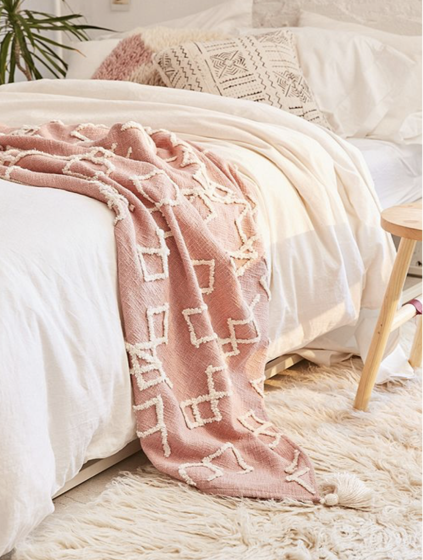 This cuddly throw is stylish and comfortable. Find it  here.