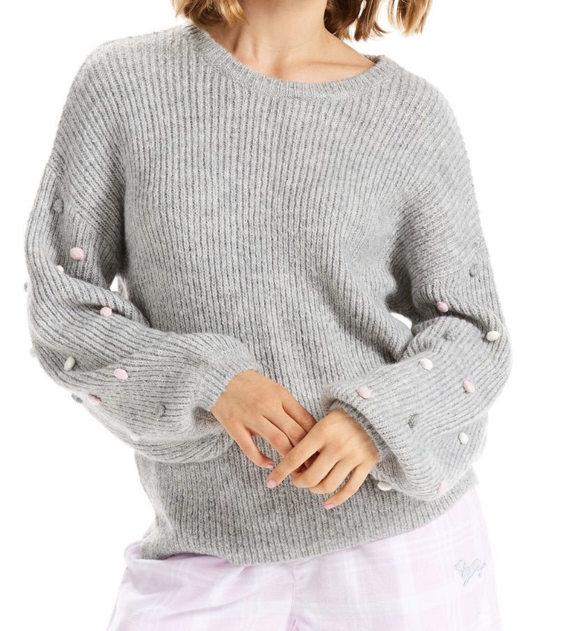 This adorable pom pom knit jumper goes well with the socks above. Find them  here. $129