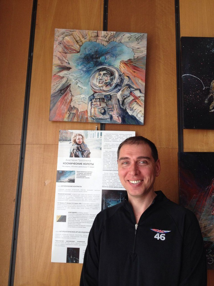 Cosmonaut Sergey Volkov in front of his portrait