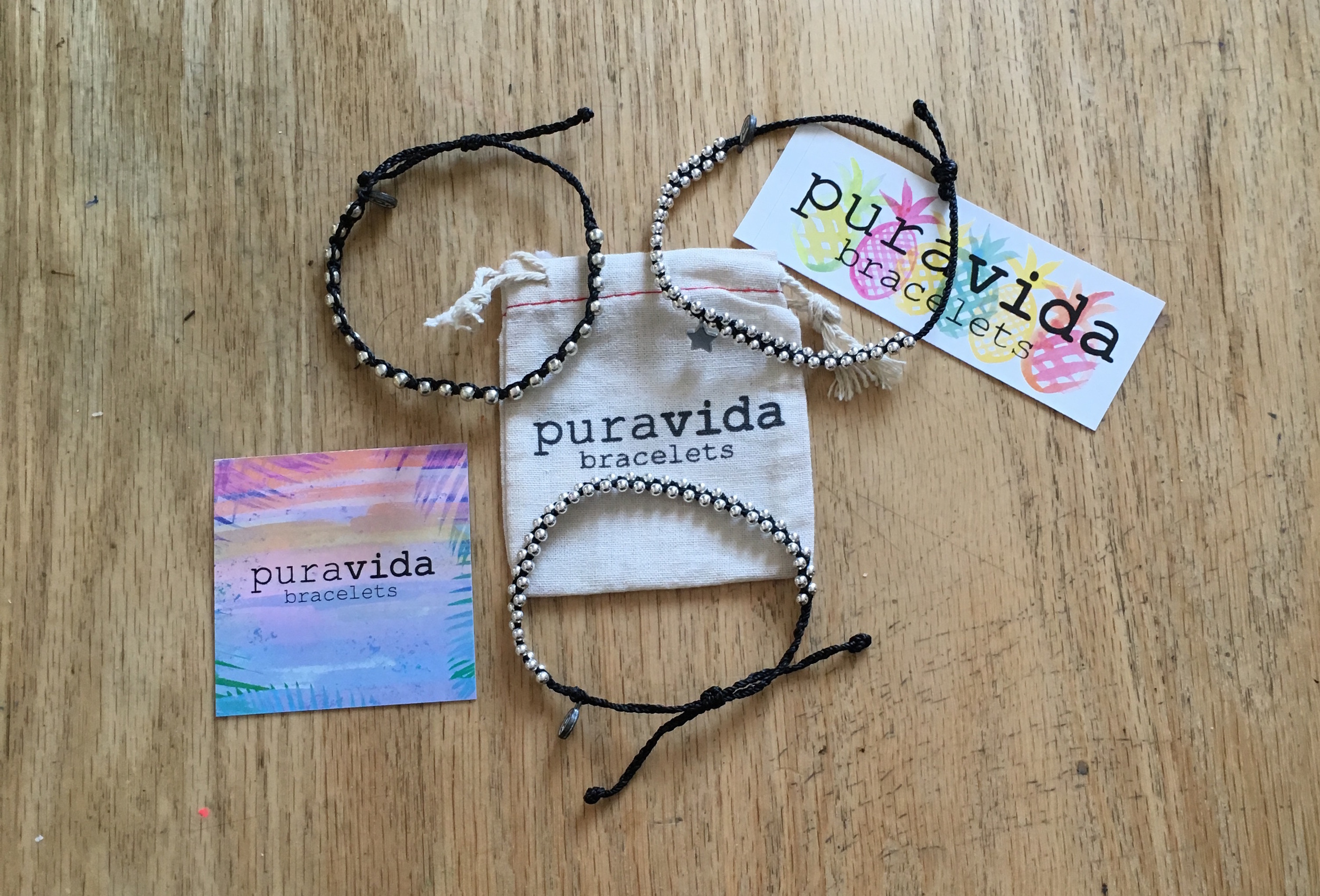 My mom bought some Pura Vida Bracelets for herself. Clockwise from left:  Black Studded .  Track Bead w/ Silver Bitty Star Black .  Silver Track Bead Black .