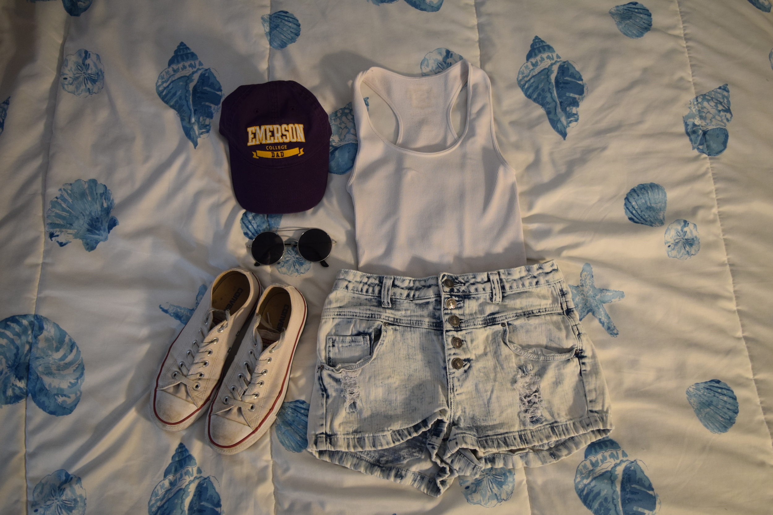 Hat .  Sunglasses  (similar).  Sneakers . Tank Top (just a basic white tank top you can get anywhere).  Shorts .