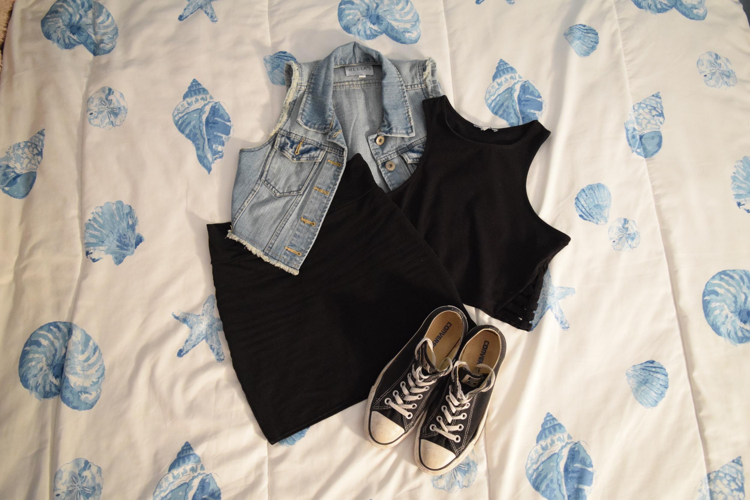 Denim Vest  (similar).  Crop Top  (similar).  Skirt  (similar).  Sneakers .