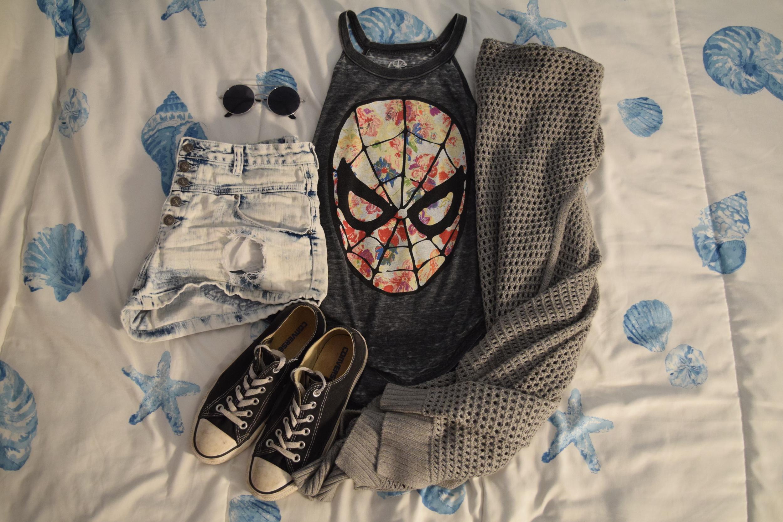 Tank (no longer being sold at  Wet Seal ).  Shorts . Sweater (no longer being sold at  The Gap ).  Shoes .  Sunglasses  (similar).