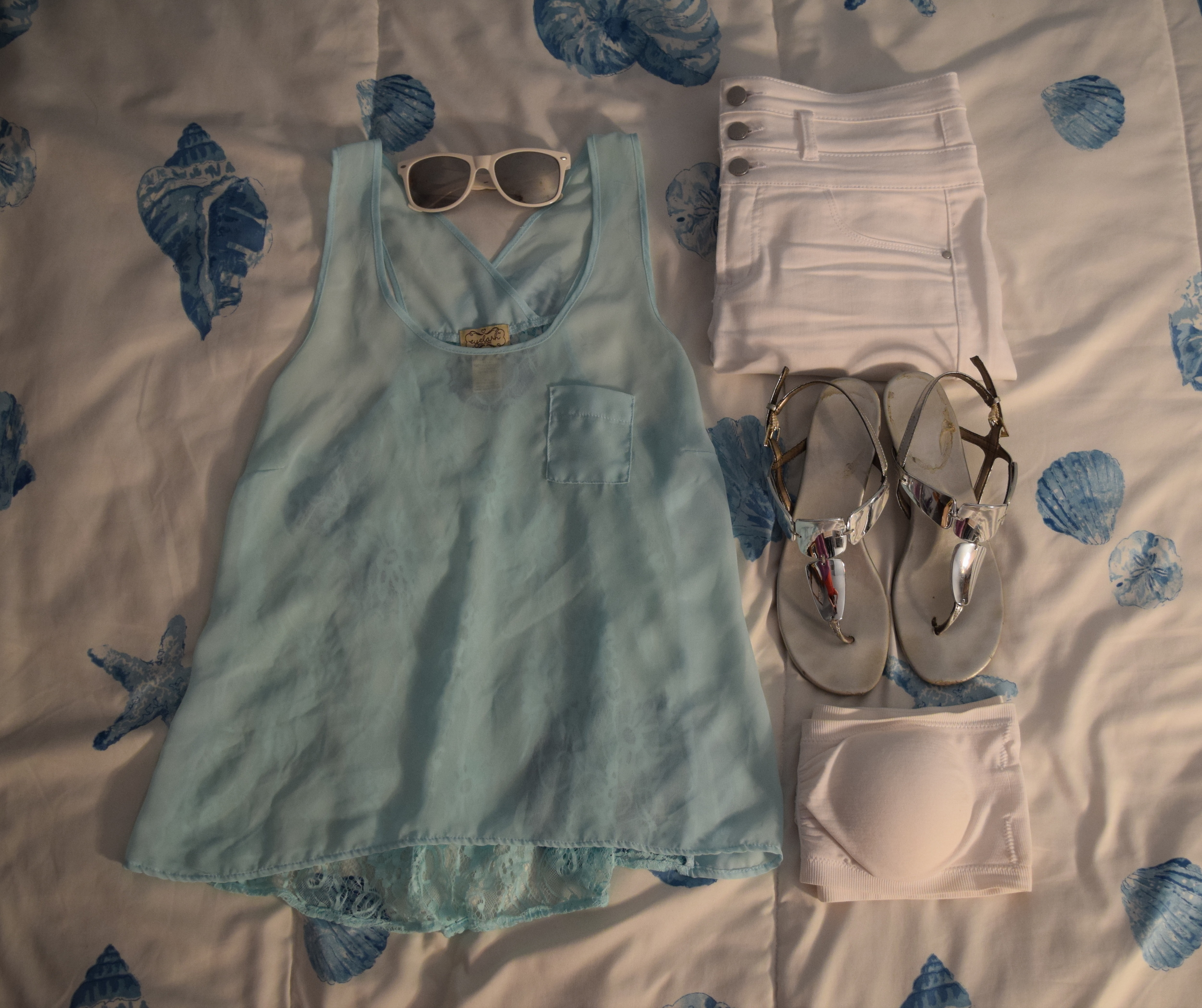 Tank Top (I honestly have no clue where I got this I'm so sorry).  Bandeau . Sandals (no longer being sold at  Payless ).  Jeans .  Sunglasses  (similar).