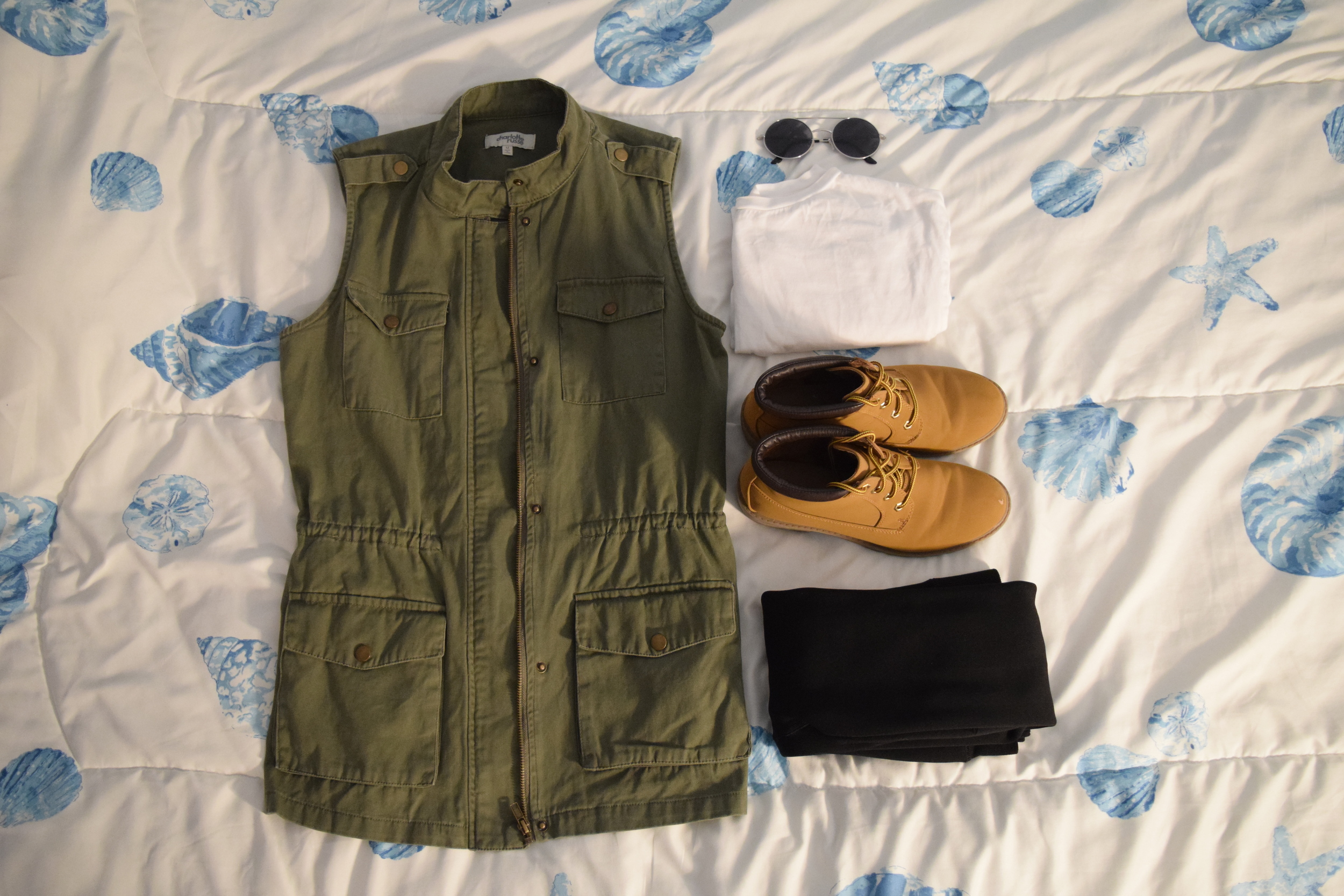 Vest .  Sunglasses  (similar).  Shirt . Boots (no longer being sold at  Primark .  Leggings .