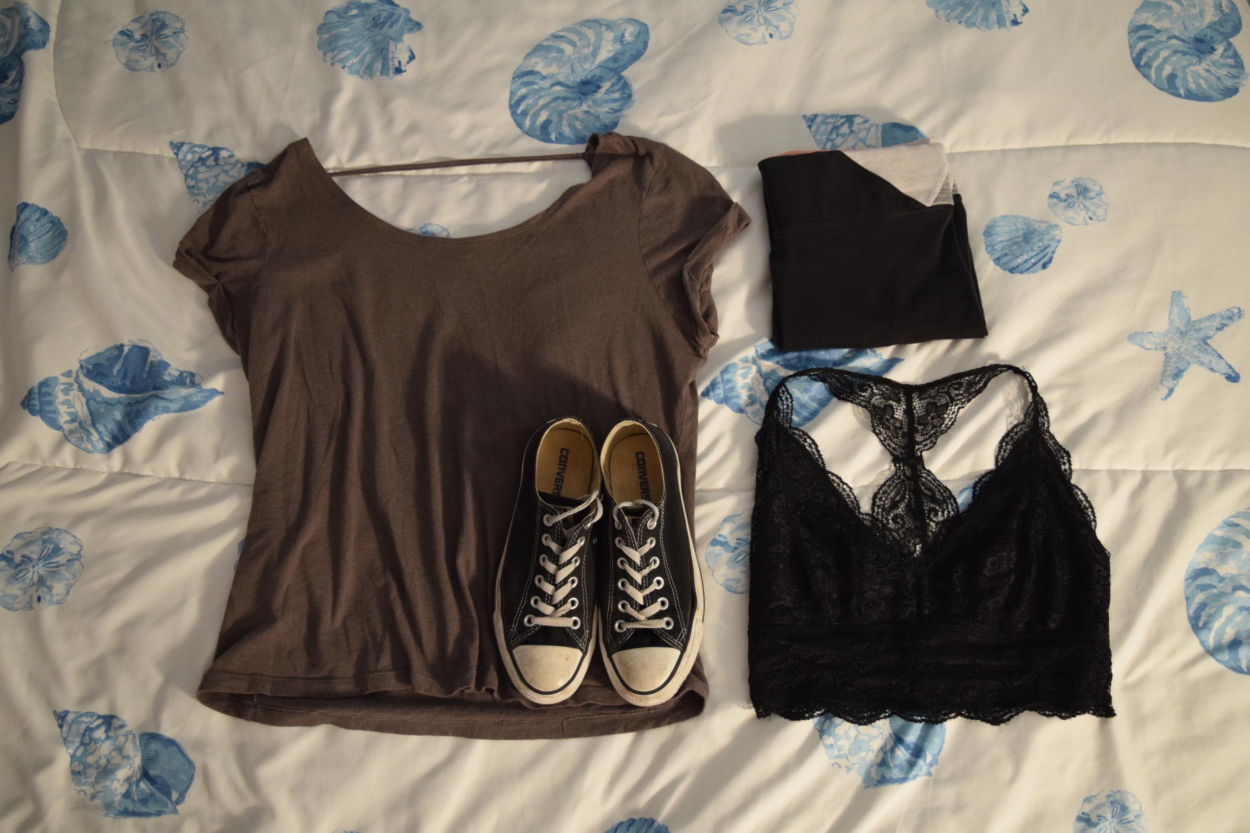 Shirt (no longer being sold at  Victoria's Secret PINK ).  Leggings  (similar).  Sneakers .  Bralette .