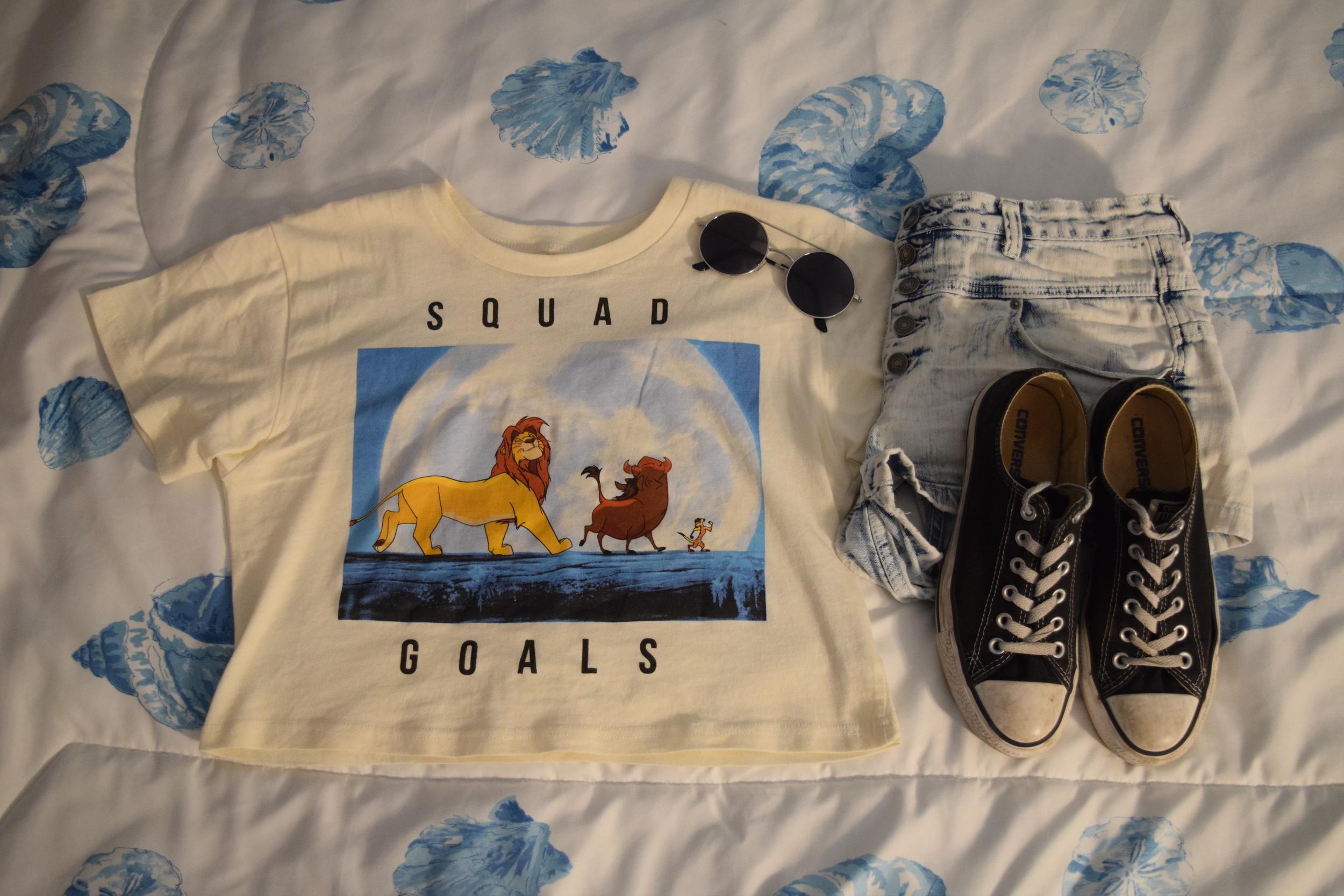 Shirt .  Shorts .  Shoes .  Sunglasses  (similar).