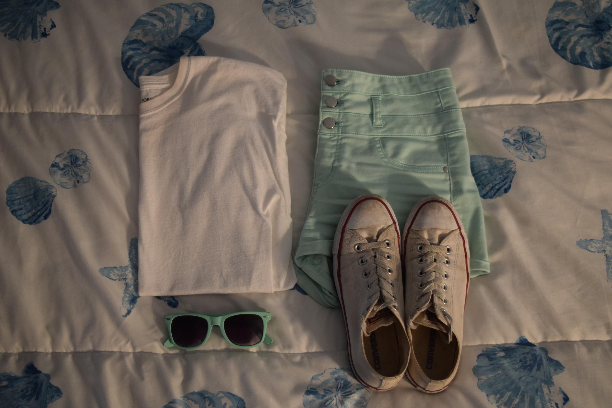 Shirt . Sunglasses (no clue I'm sorry).  Sneakers .  Shorts .
