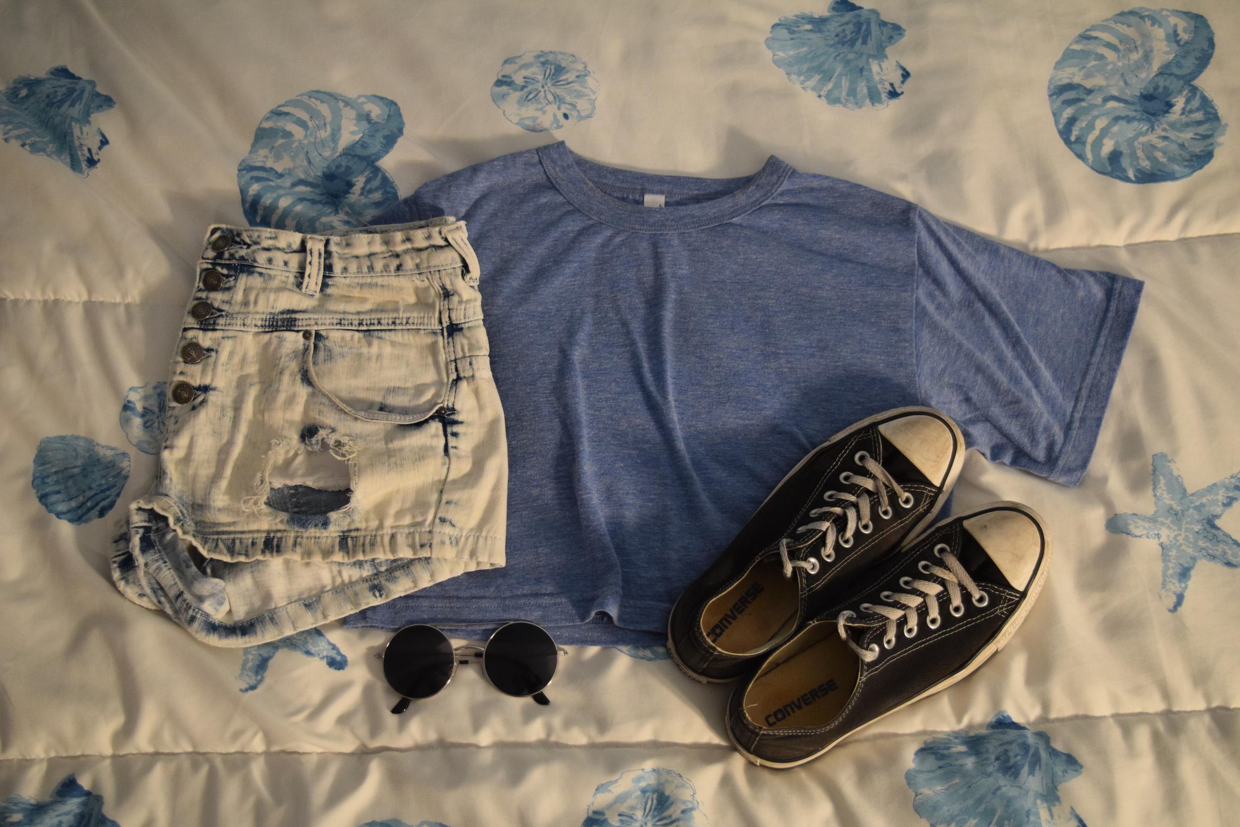 Shirt .  Shorts .  Sneakers .  Sunglasses  (similar).