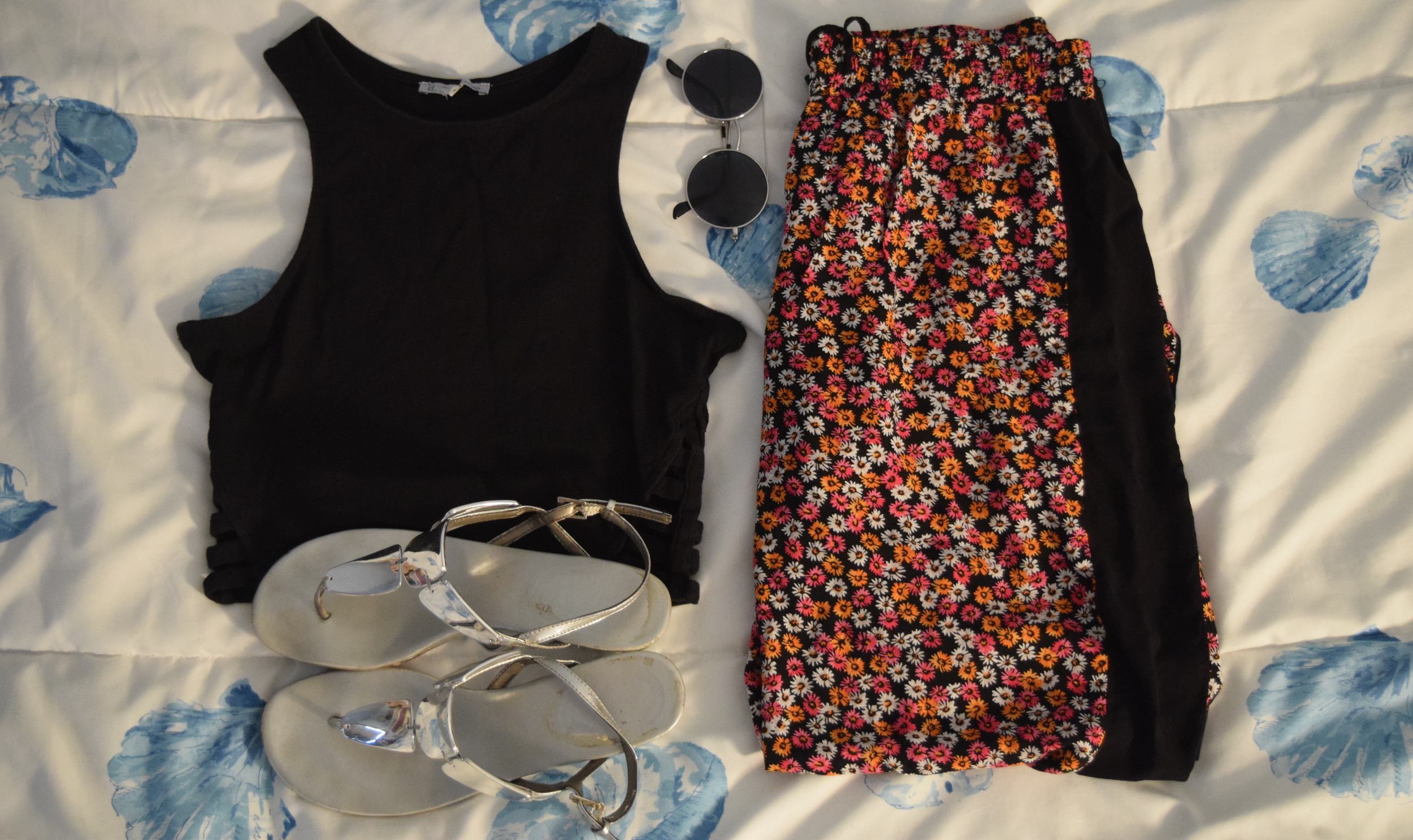 Top  (similar).  Pants .  Sunglasses  (similar). Sandals (no longer being sold at  Payless ).