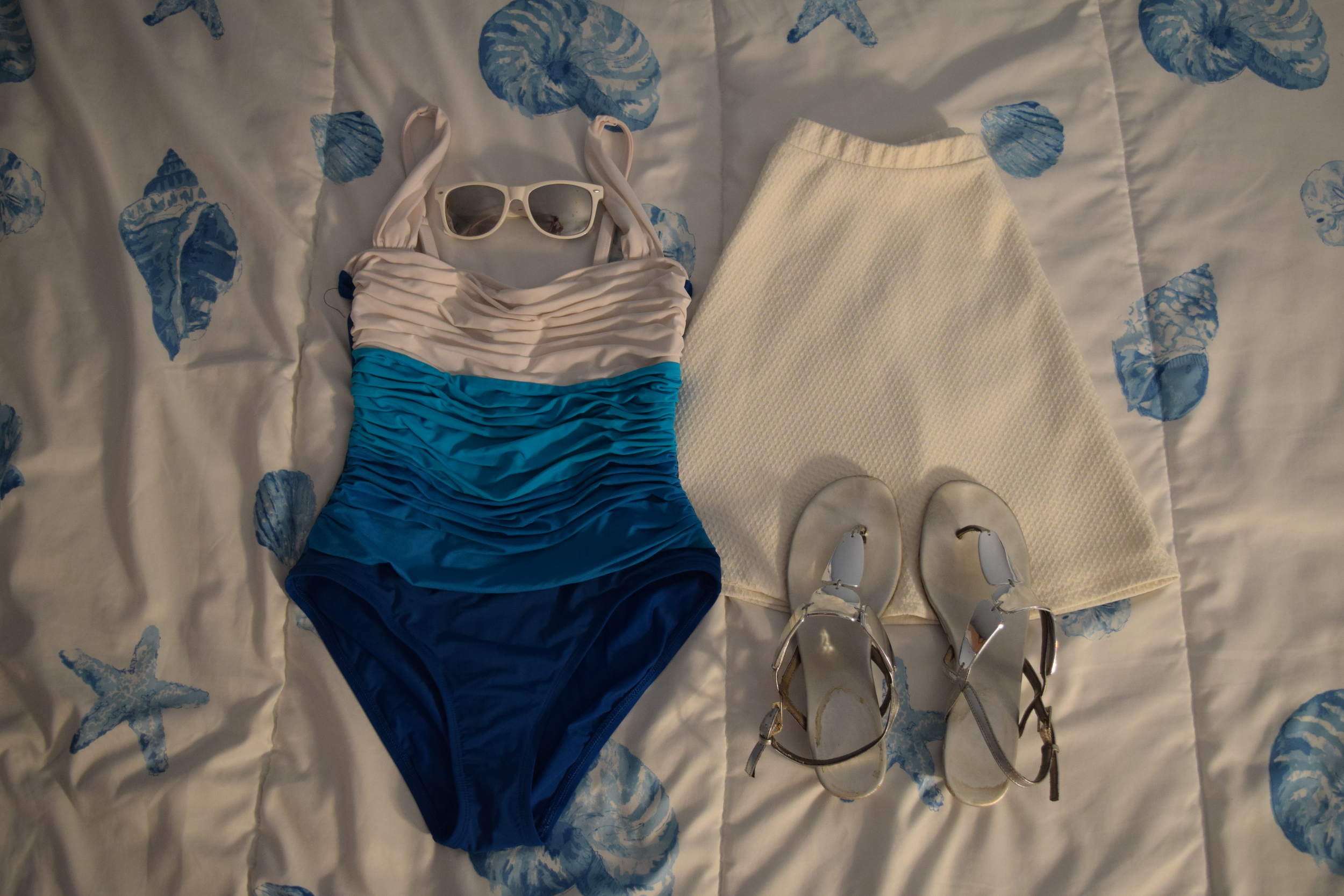 Swimsuit (no longer being sold at  Estelle's Dressy Dresses ).  Sunglasses  (similar).  Skirt . Sandals (no longer being sold at  Payless ).