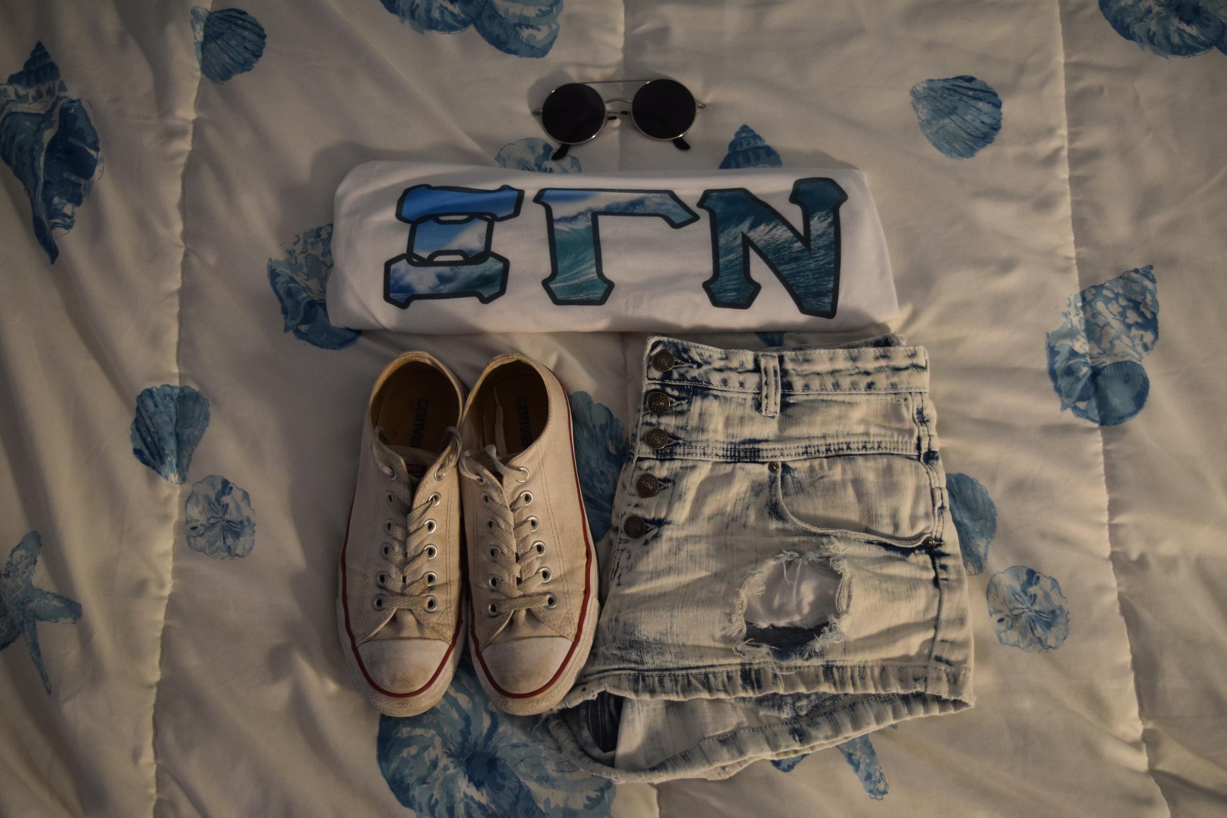 Tank Top .  Shorts .  Sneakers .  Sunglasses  (similar).
