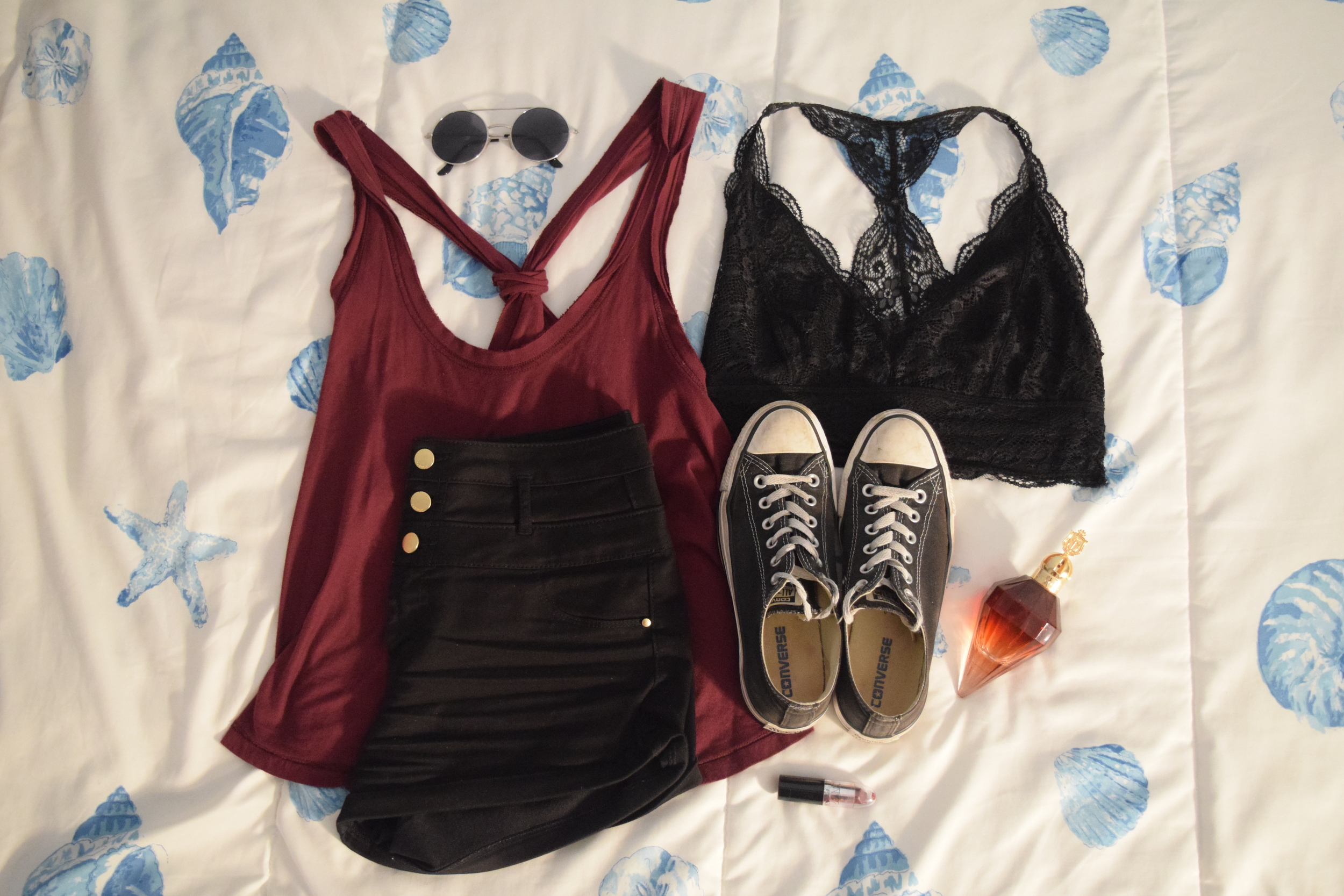 Tank (no longer being sold at  Urban Outfitters ).  Shorts .  Bralette .  Sneakers .  Perfume .  Lipstick .  Sunglasses (similar).