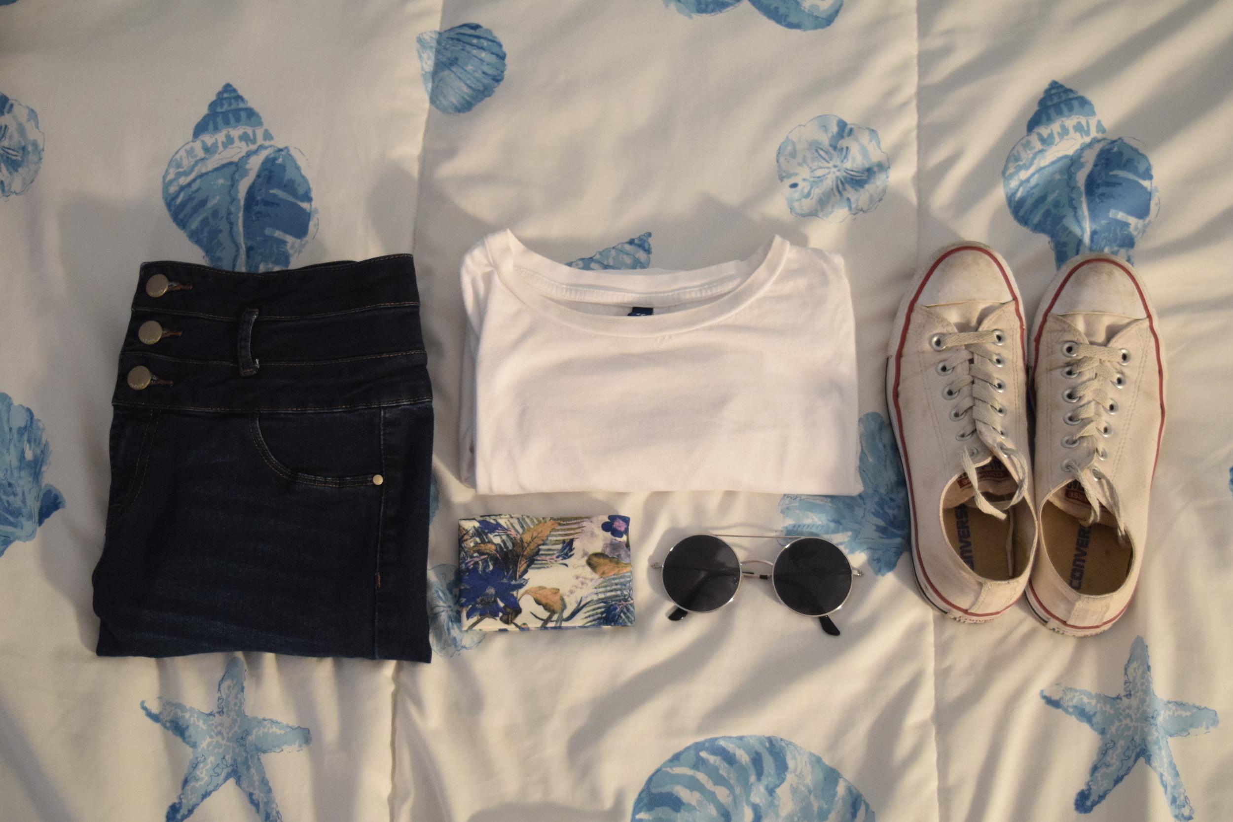 Shirt .  Jeans .  Sneakers .  Headband .  Sunglasses  (similar).
