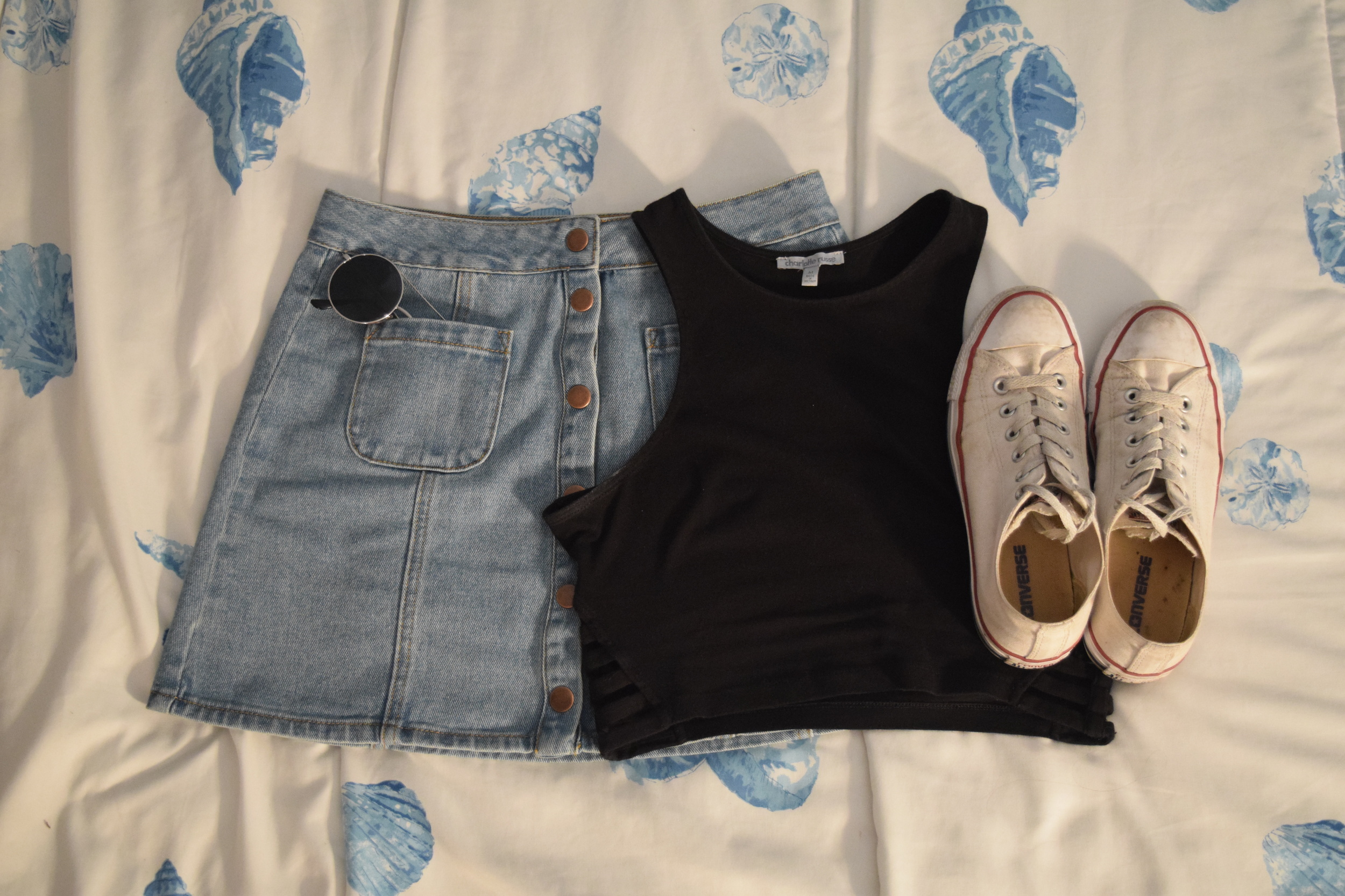 Top  (similar).  Skirt  (different color).  Sneakers .  Sunglasses  (similar).