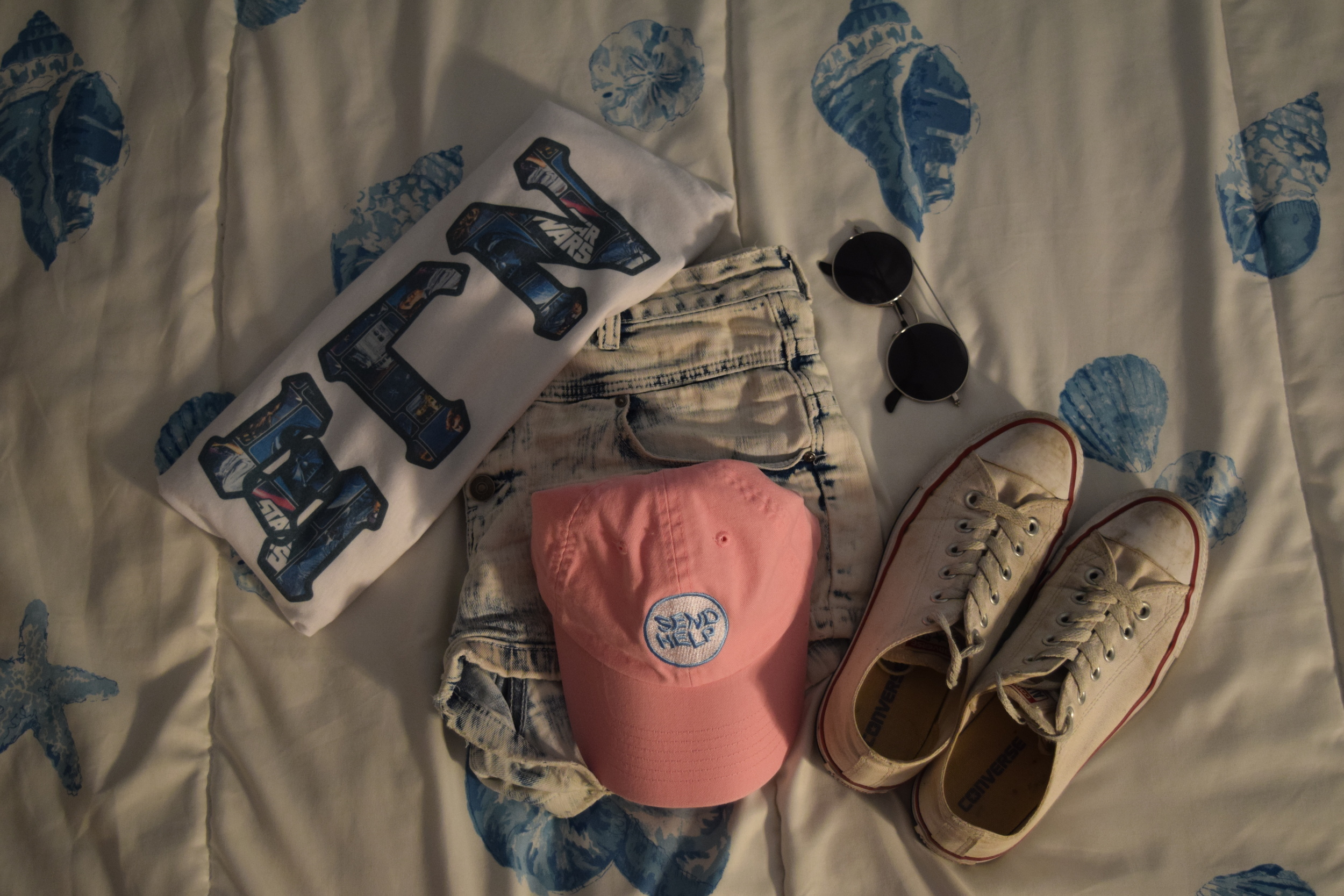 Shirt .  Shorts .  Hat .  Sneakers .  Sunglasses  (similar).