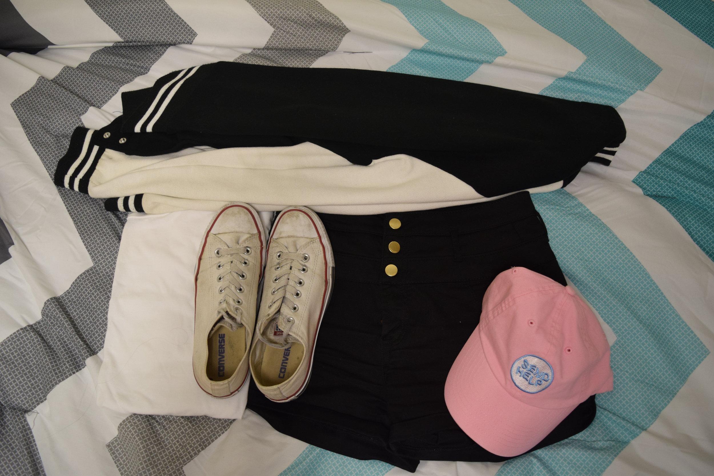 Shirt .  Shorts .  Sneakers .  Hat .  Jacket  (similar).