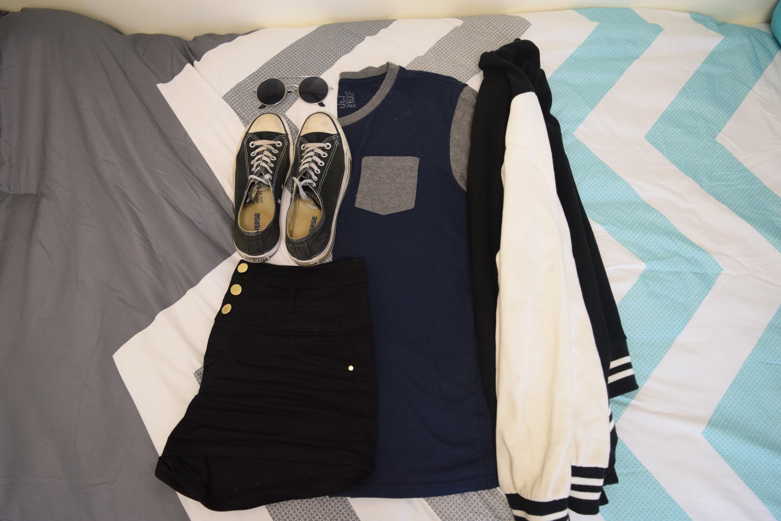 Shirt .  Shorts .  Jacket  (similar).  Sneakers .  Sunglasses  (similar).