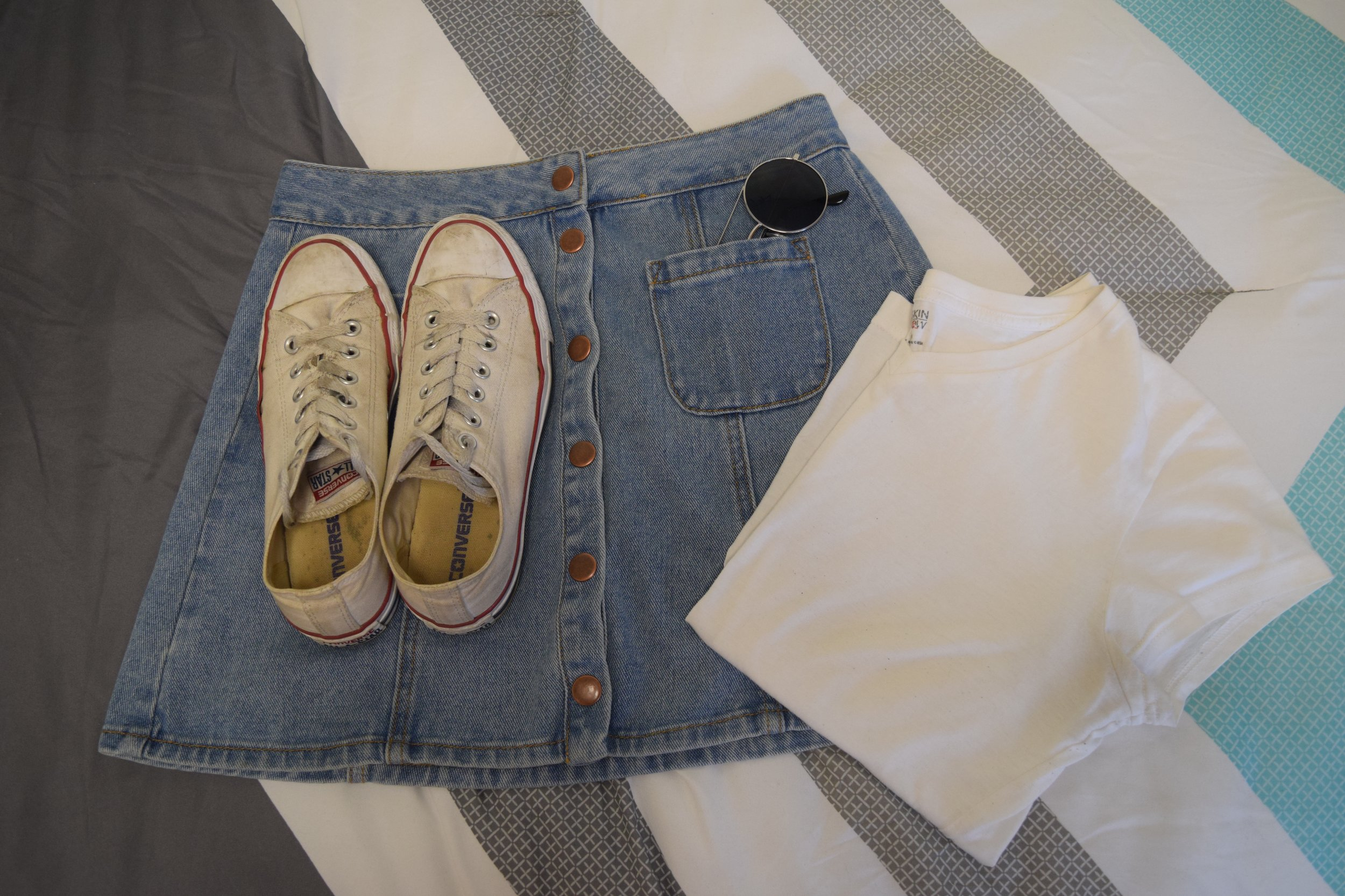 Shirt .  Skirt  (different color).  Sneakers .  Sunglasses  (similar).