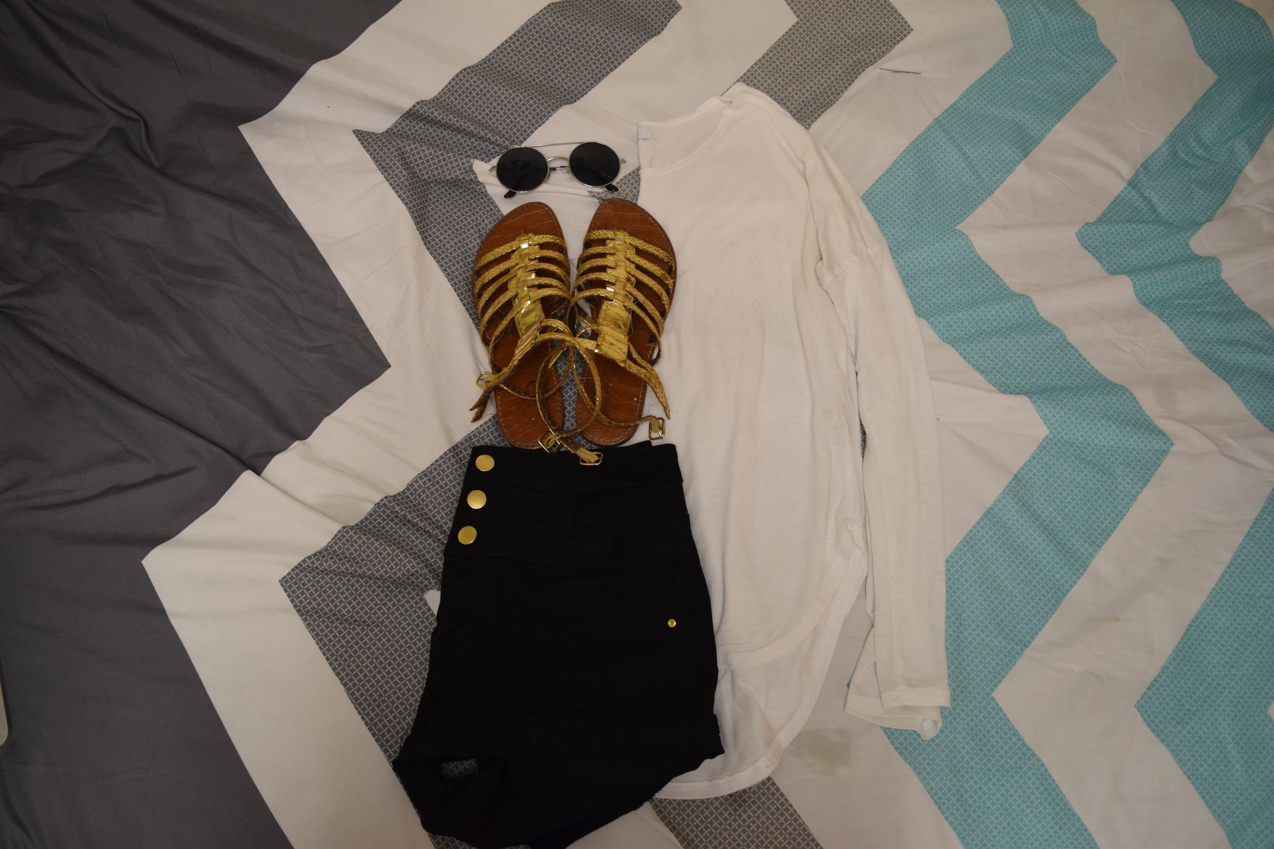 Shirt (no longer being sold at  dELiA*s ).  Shorts . Sandals (no longer being sold at  Sam Edelman ).  Sunglasses  (similar).