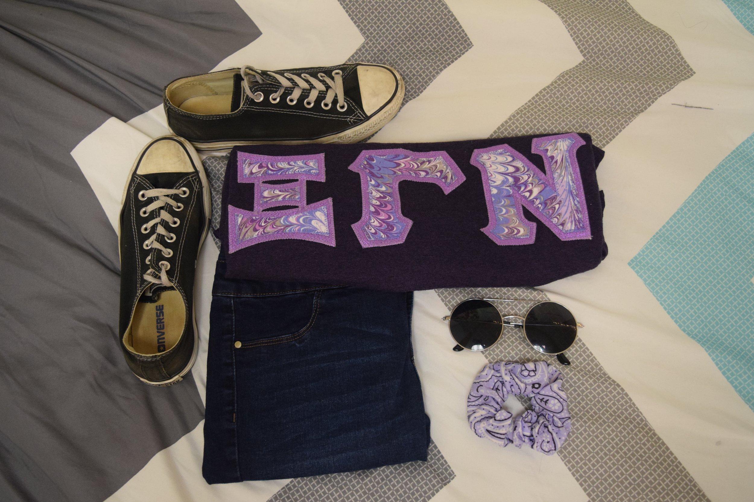 Shirt .  Jeans .  Sneakers .  Sunglasses  (similar).  Scrunchie .