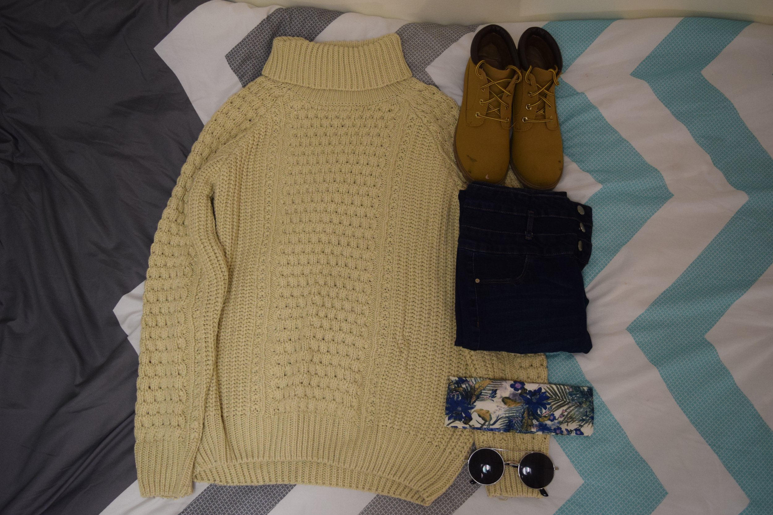 Sweater and Boots (no longer being sold at  Primark ).  Jeans .  Headband .  Sunglasses  (similar).