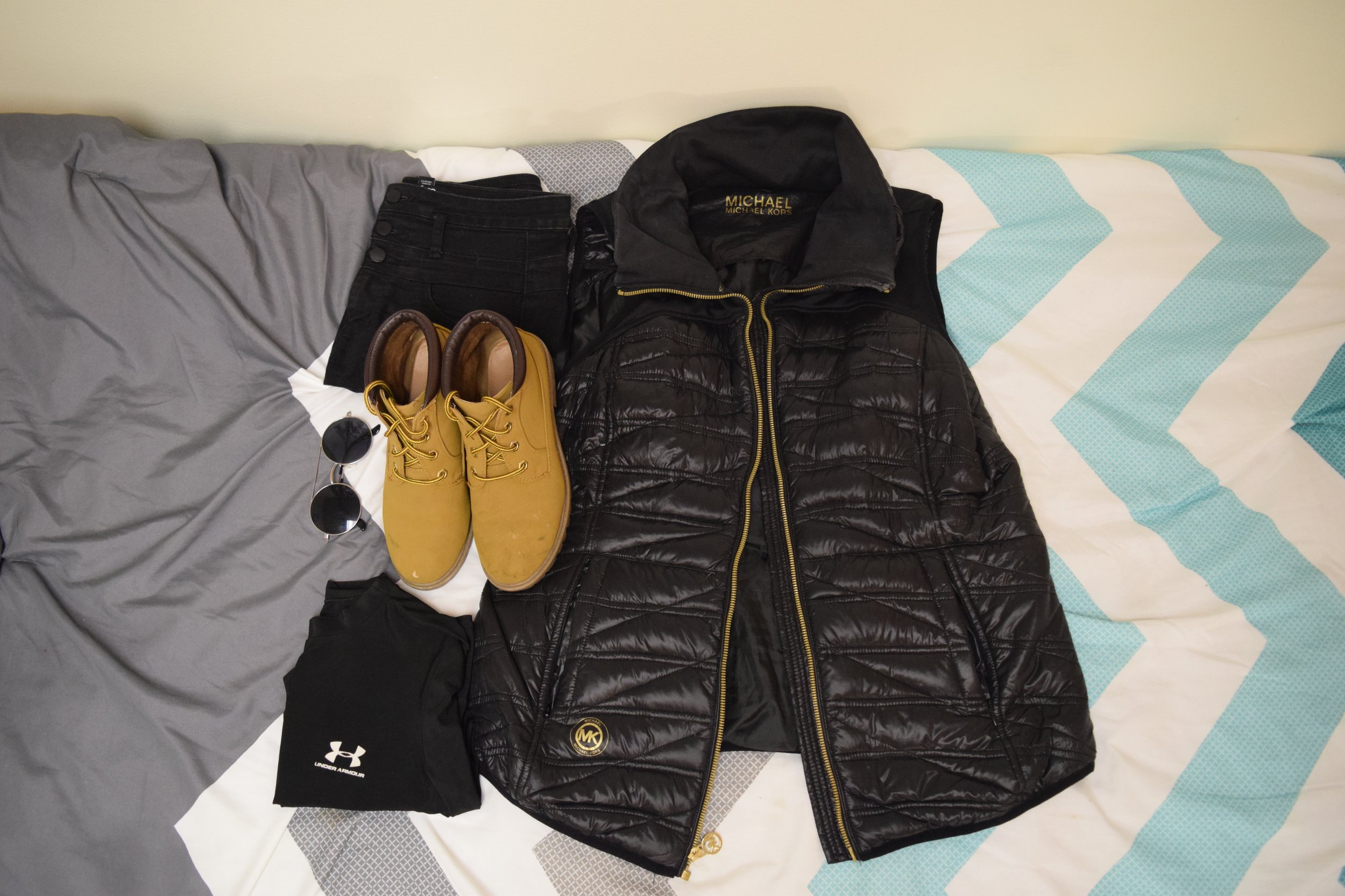 Vest .  Shirt  (similar).  Jeans . Boots (no longer being sold at  Primark ).  Sunglasses  (similar).