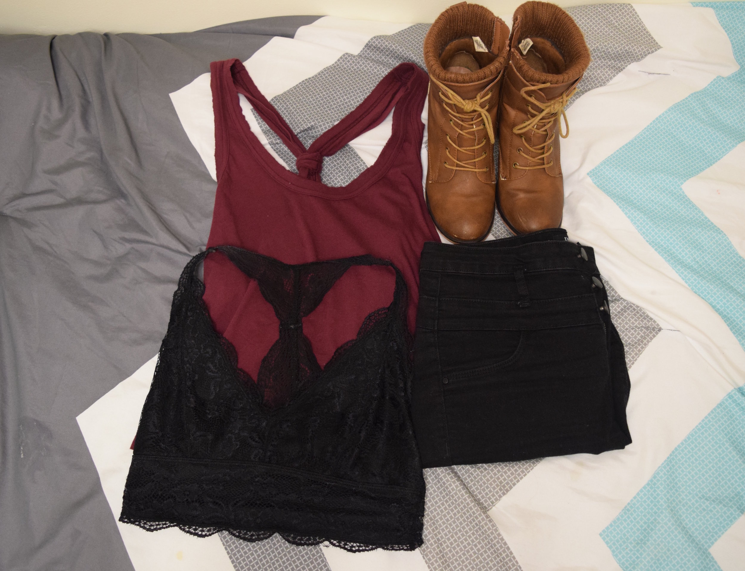 Top (no longer being sold at  Urban Outfitters ).  Bralette .  Jeans . Boots (no longer being sold at  Call It Spring ).