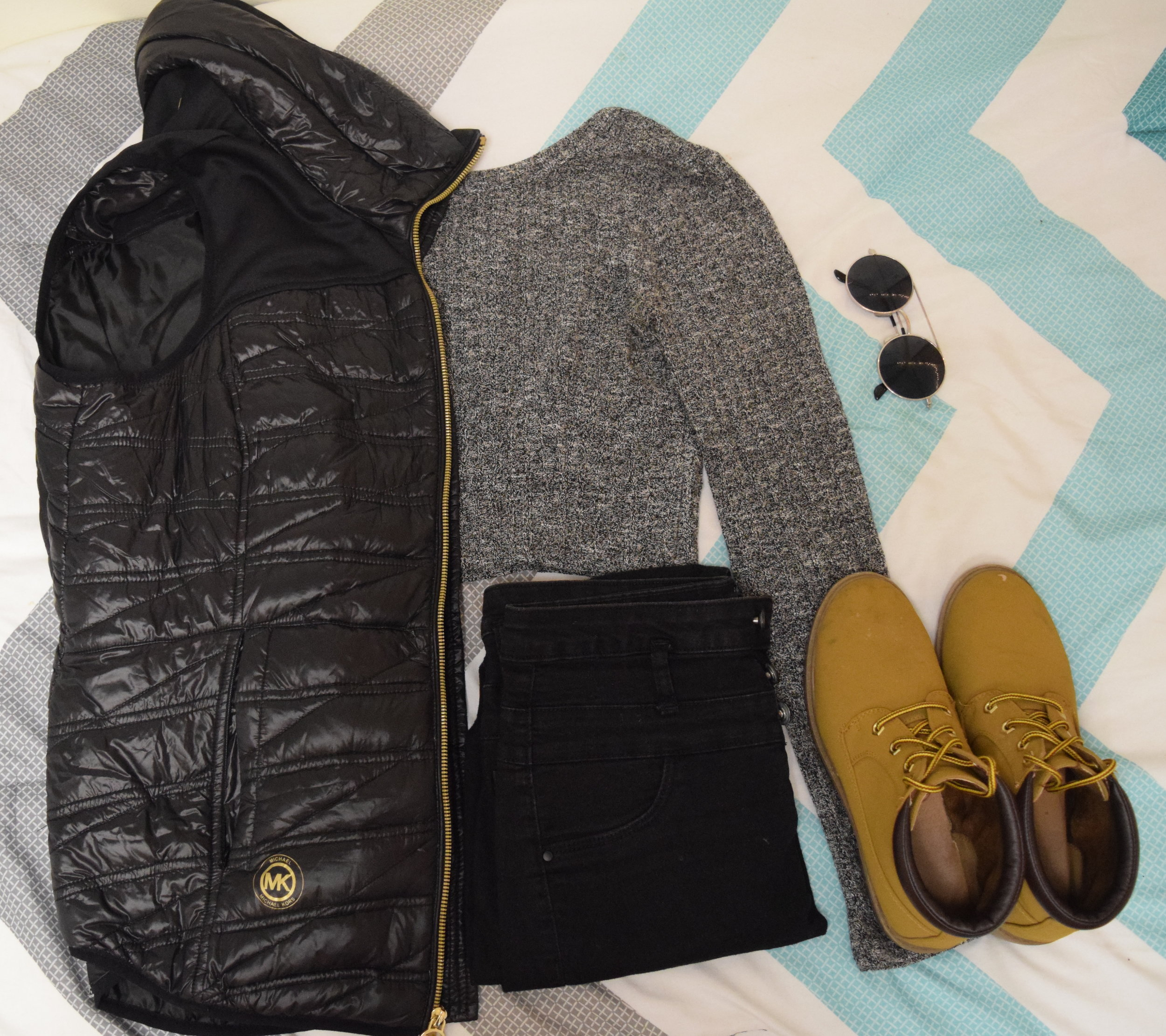 Vest .  Sweater  (similar).  Jeans . Boots (no longer being sold at  Primark ).  Sunglasses  (similar).
