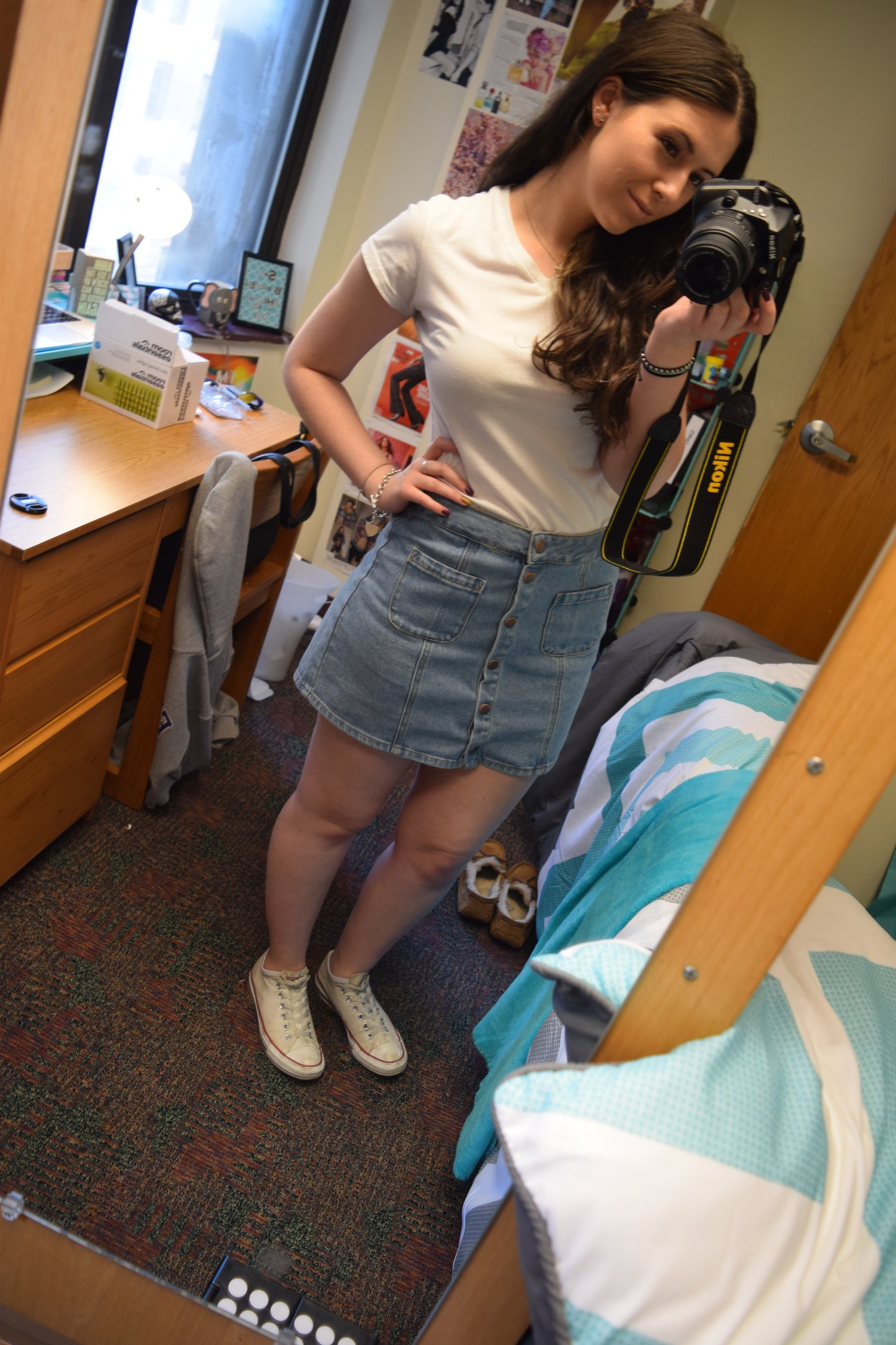 Shirt  .  Skirt  (different color).  Sneakers  .
