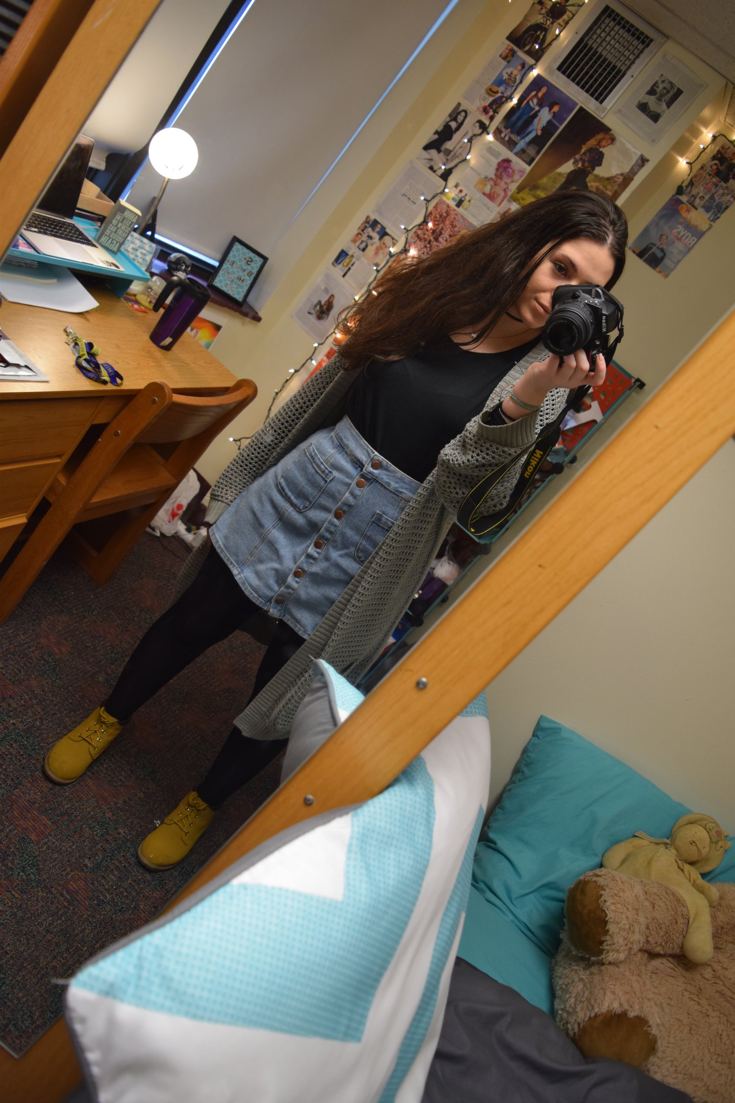 Shirt (no longer being sold at   dELiA*s  ).  Skirt  (different color).  Stockings  .  Sweater (no longer being sold at   The Gap  ). Boots (no longer being sold at   Primark  ).