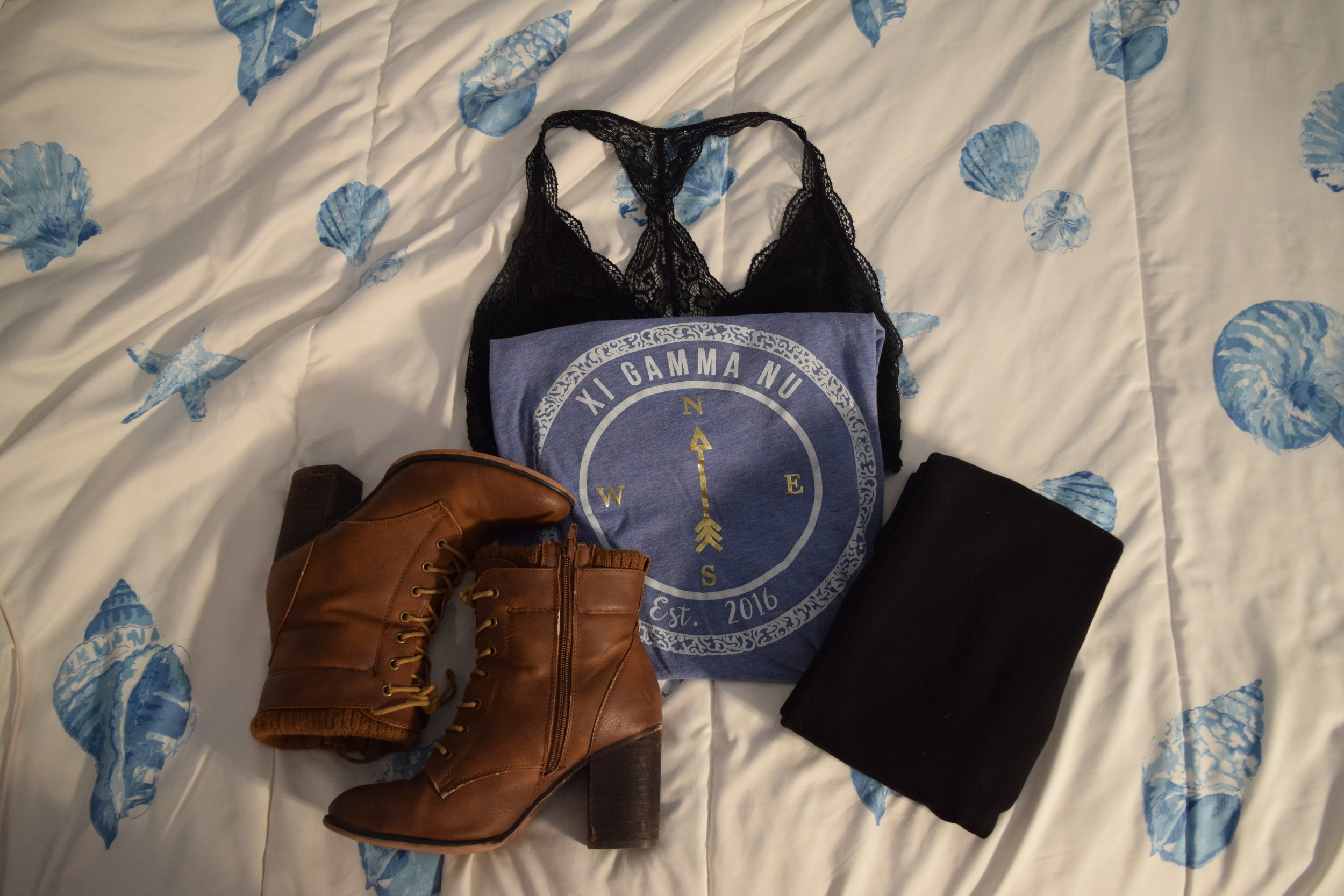Shirt (exclusive to Xi Gamma Nu Emerson College).  Leggings . Boots (no longer being sold by  Call It Spring ).  Bralette .