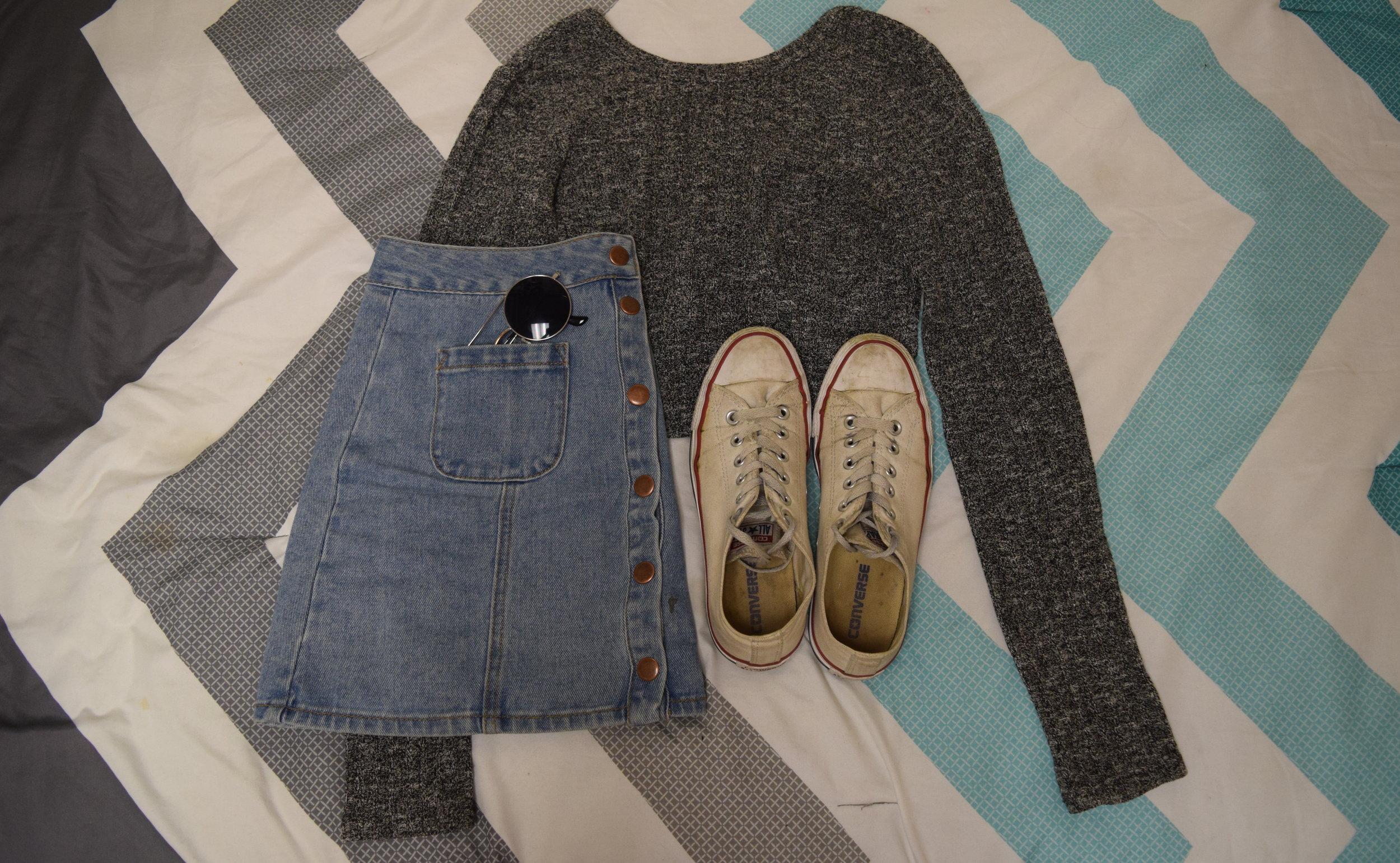 Sweater  (similar).  Skirt  (different color).  Sneakers .  Sunglasses  (similar).