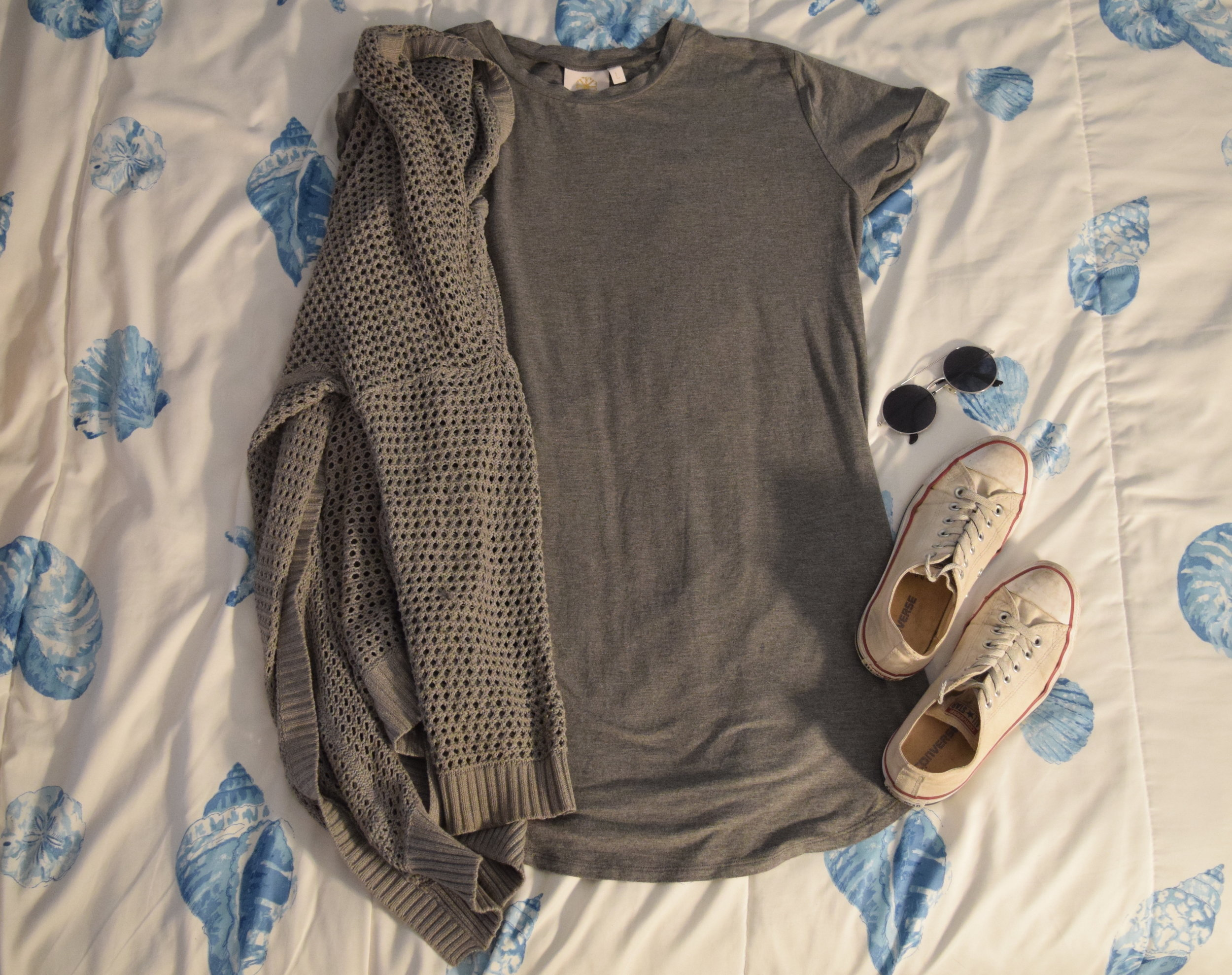 Dress . Sweater (no longer being sold at  The Gap ).  Sneakers .  Sunglasses  (similar).