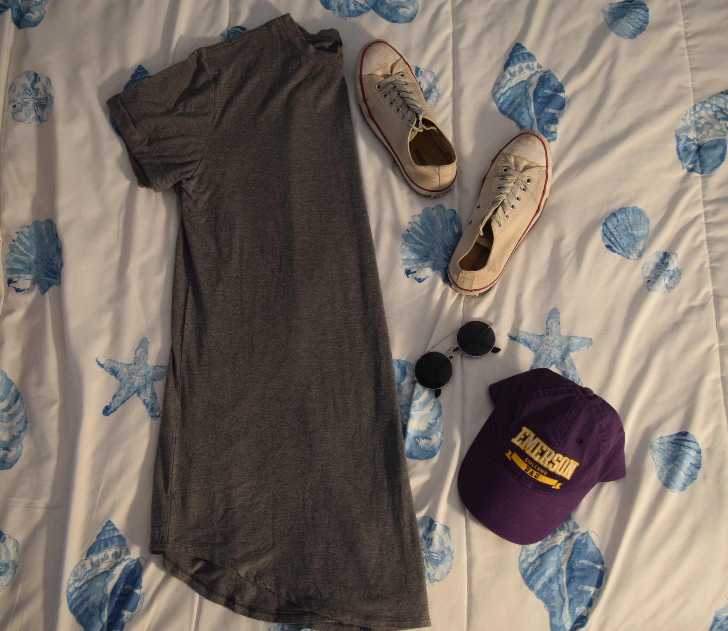 Dress .  Hat .  Sneakers .  Sunglasses  (similar).