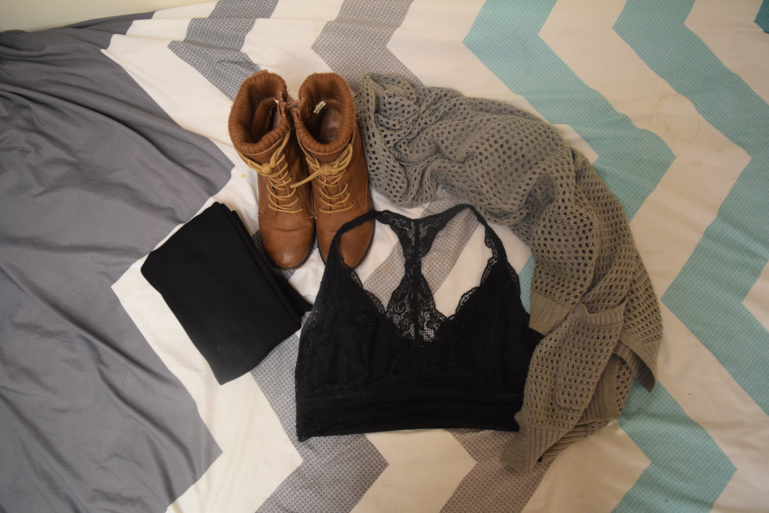Bralette . Sweater (no longer being sold at  the Gap ).  Leggings .  Boots (no longer being sold at  Call It Spring ).