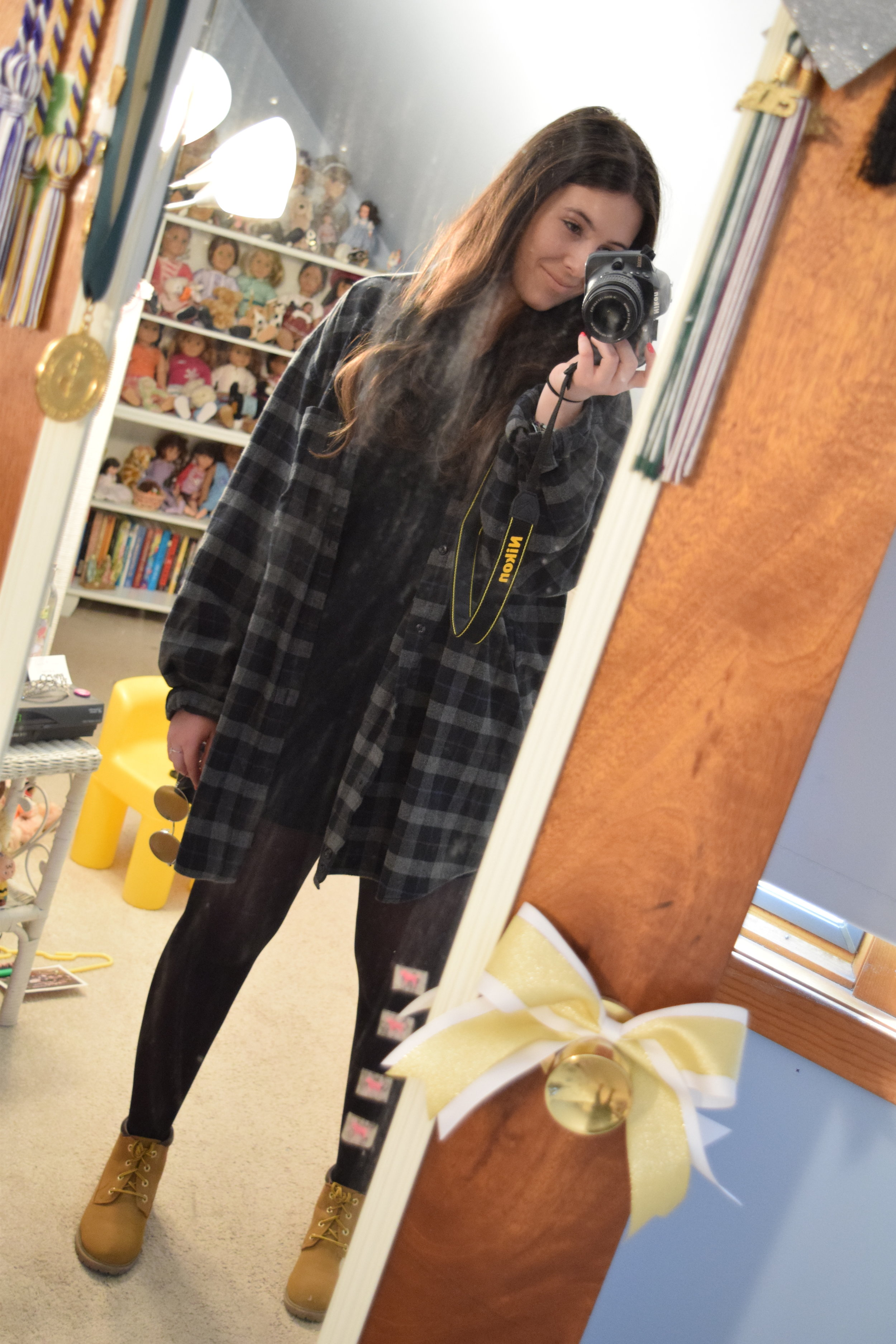 Flannel (no longer being sold at  Eddie Bauer ). Dress . Boots (no longer being sold at  Primark ). Tights . Sunglasses (similar)