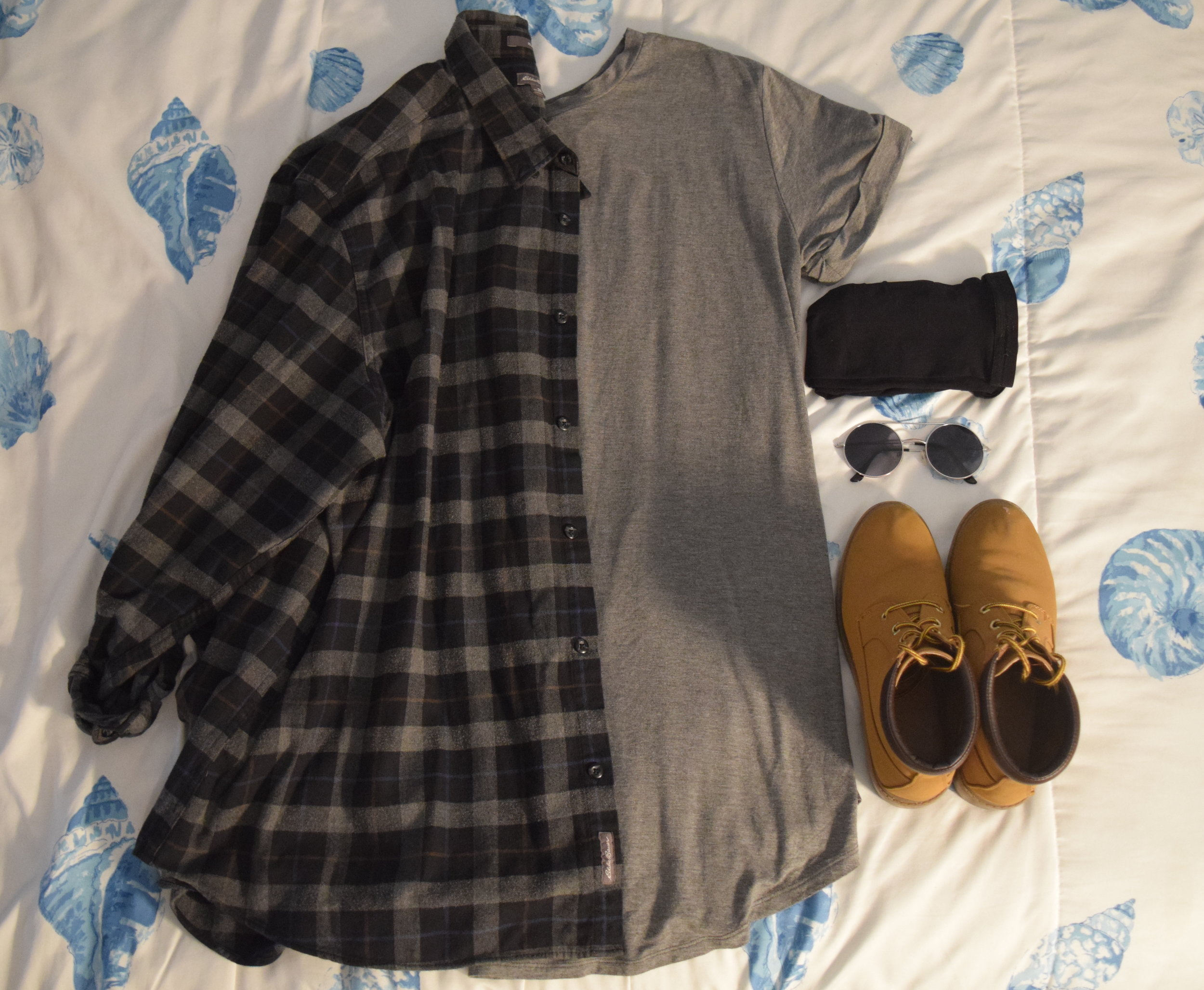 Dress . Flannel (no longer being sold at  Eddie Bauer ). Stockings . Sunglasses (similar). Boots (no longer being sold at  Primark ).