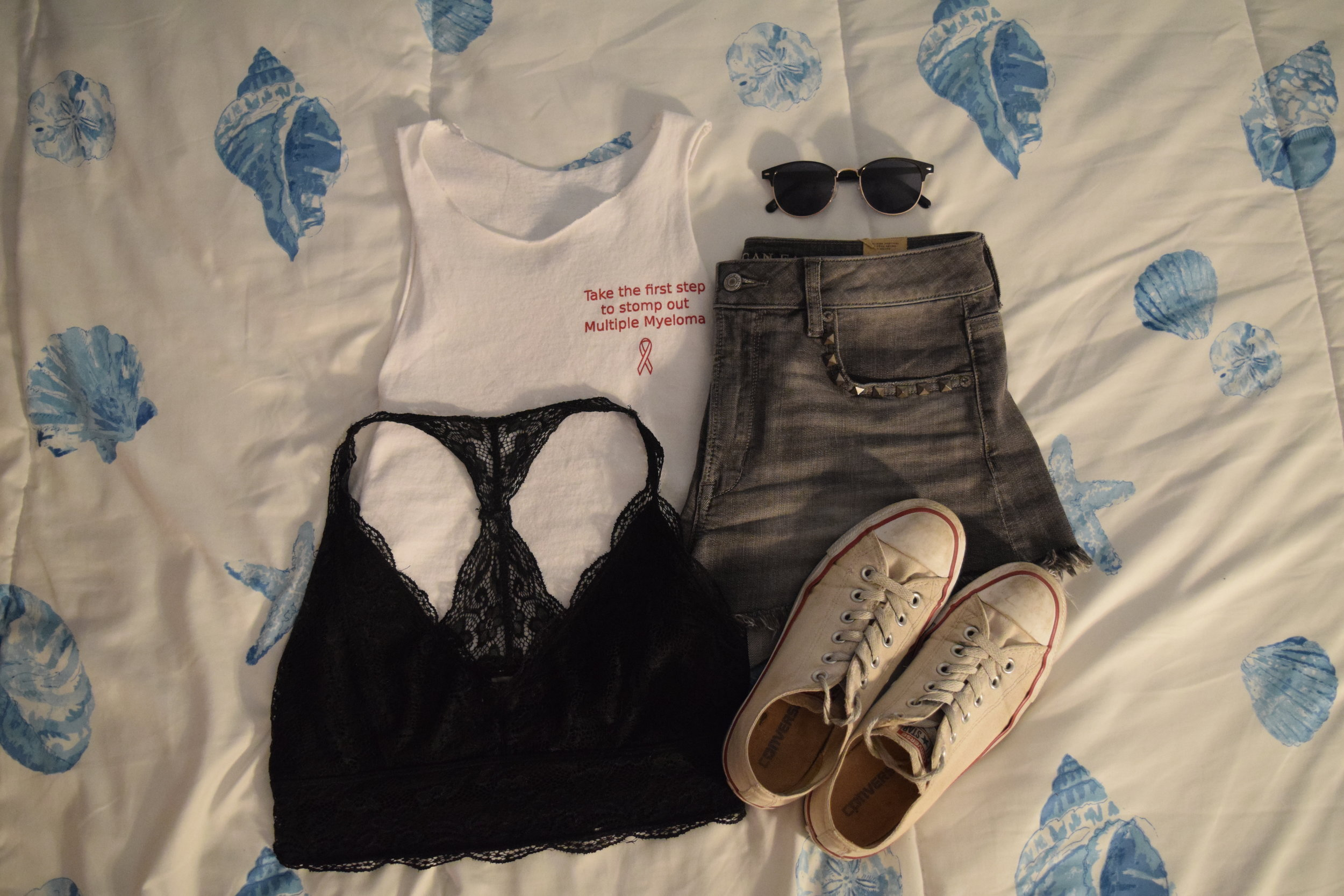 Shirt (no longer being sold by Xi Gamma Nu but make a donation  here  anyway).  Shorts .  Bralette .  Sneakers .  Sunglasses .