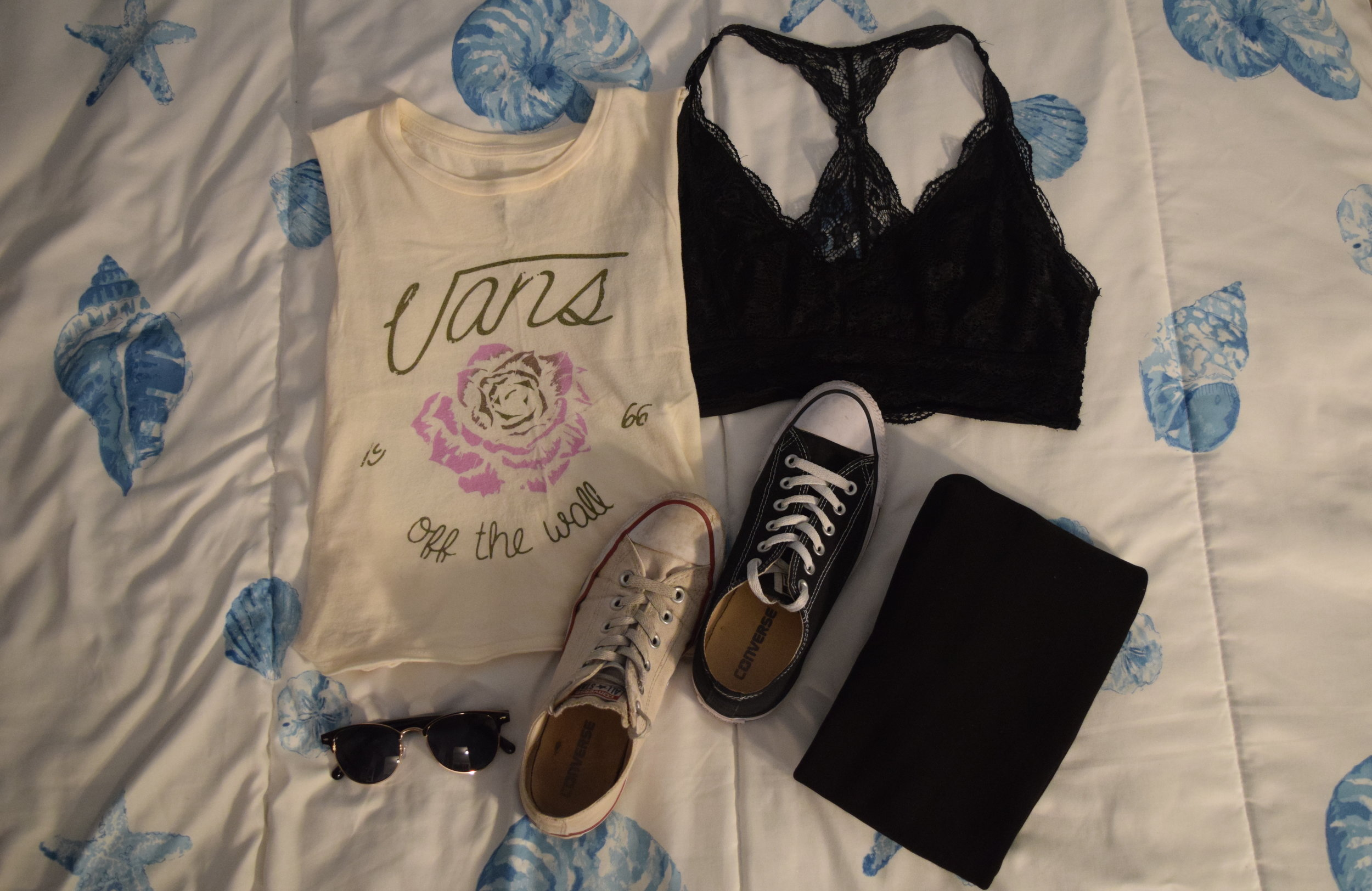 Shirt (no longer being sold at  Vans ).  Bralette .  Leggings .  White Converse .  Black Converse .  Sunglasses .
