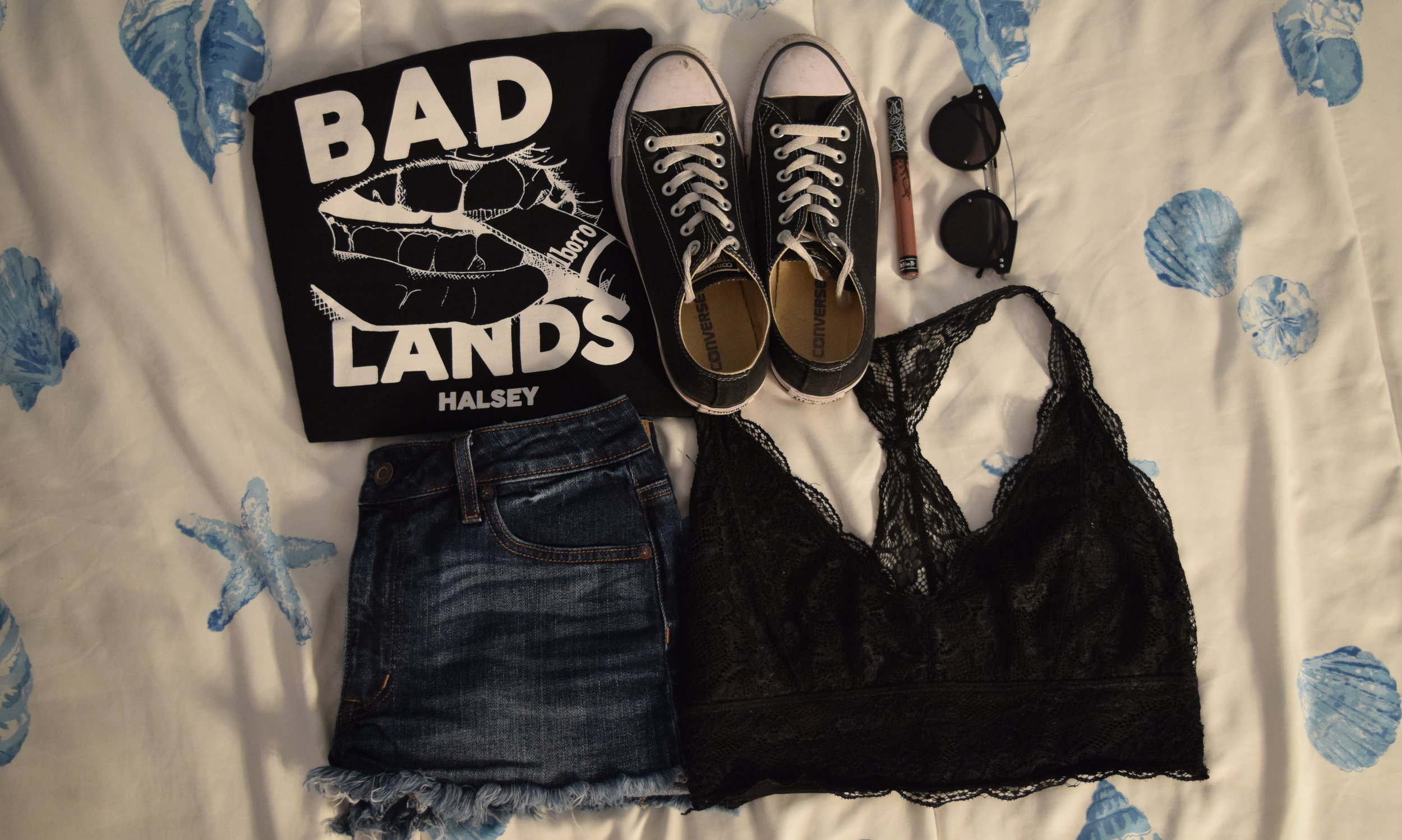 Tank (no longer being sold through  Halsey's store ).  Shorts .  Bralette .  Sneakers .  Lipgloss (in Sanctuary).  Sunglasses .
