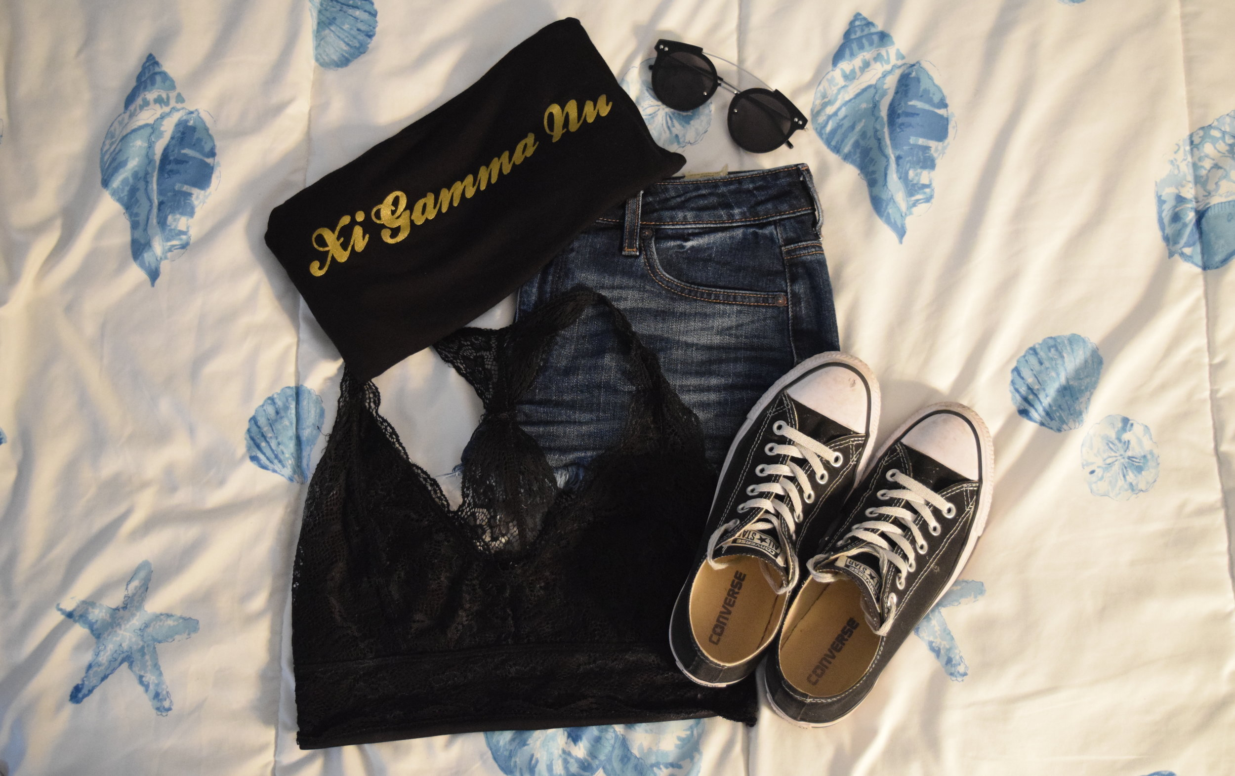 Shirt (Gamma exclusive bbs).  Shorts .  Bralette .  Converse .  Sunglasses .