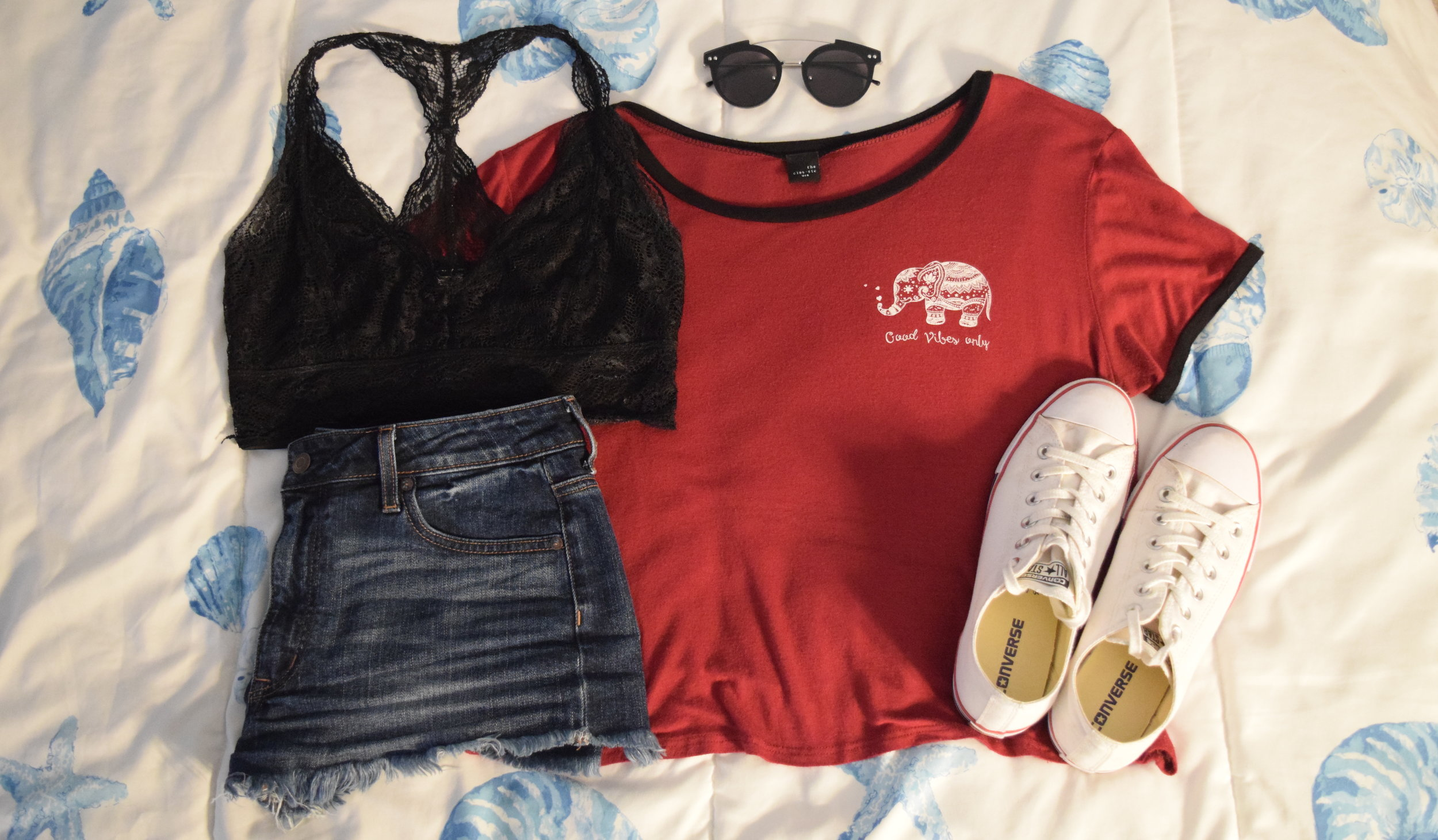 Shirt (no longer being sold at  Mystique Boutique NYC ).  Bralette .  Shorts .  Sneakers .  Sunglasses .