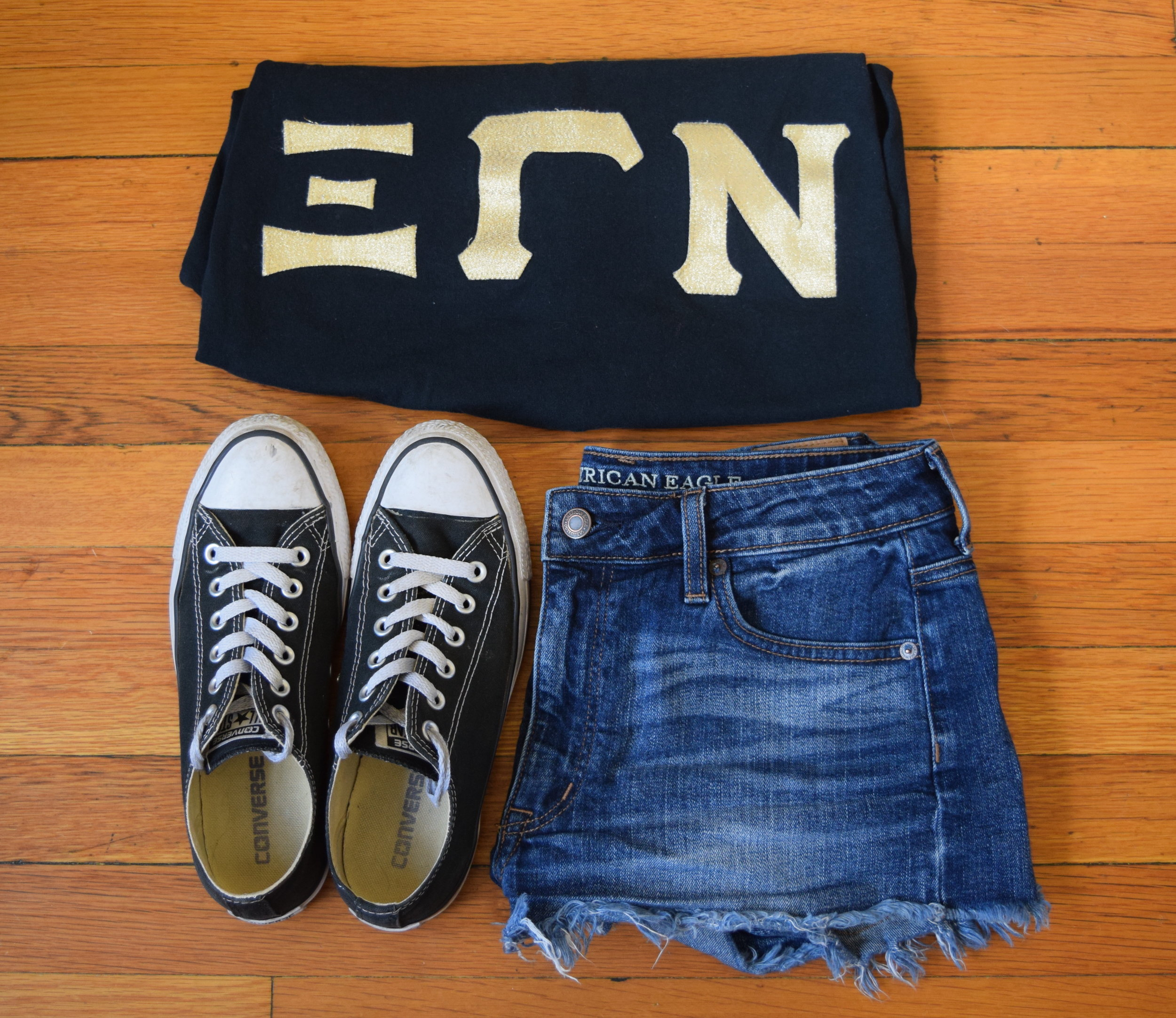 shirt .  shorts .  sneakers .