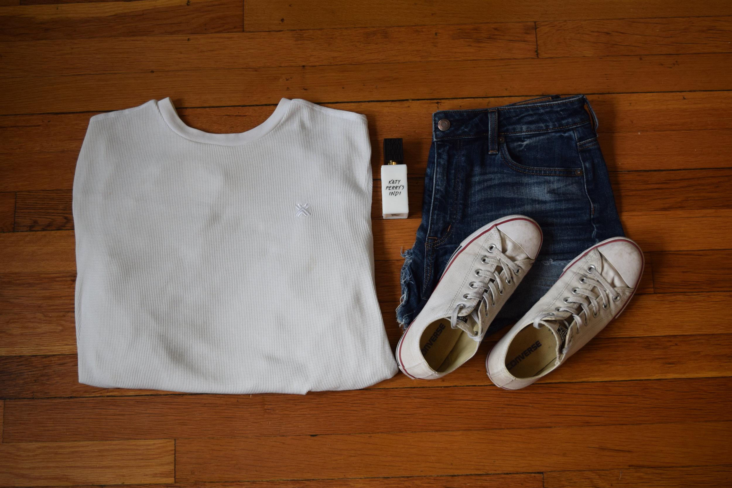 shirt (i think it's  armani ?).  shorts .  sneakers .  perfume .